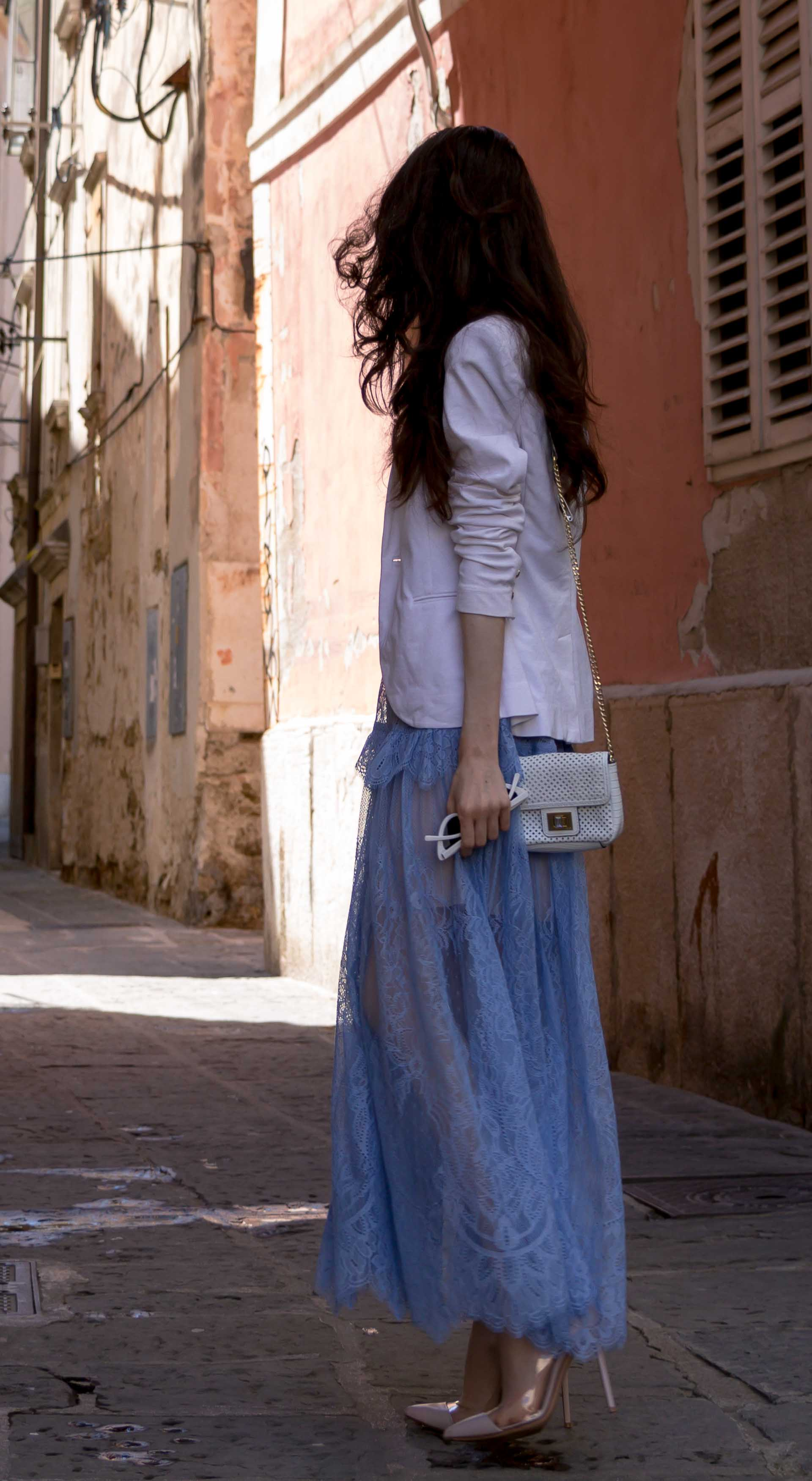 Veronika Lipar Fashion Blogger of Brunette from Wall Street dressed in Self-Portrait blue lace midi dress, white single button blazer, blush Gianvito Rossi plexi pumps, white shoulder bag, Lespecs white cat eye sunglasses while walking in a hidden alley in Italian village