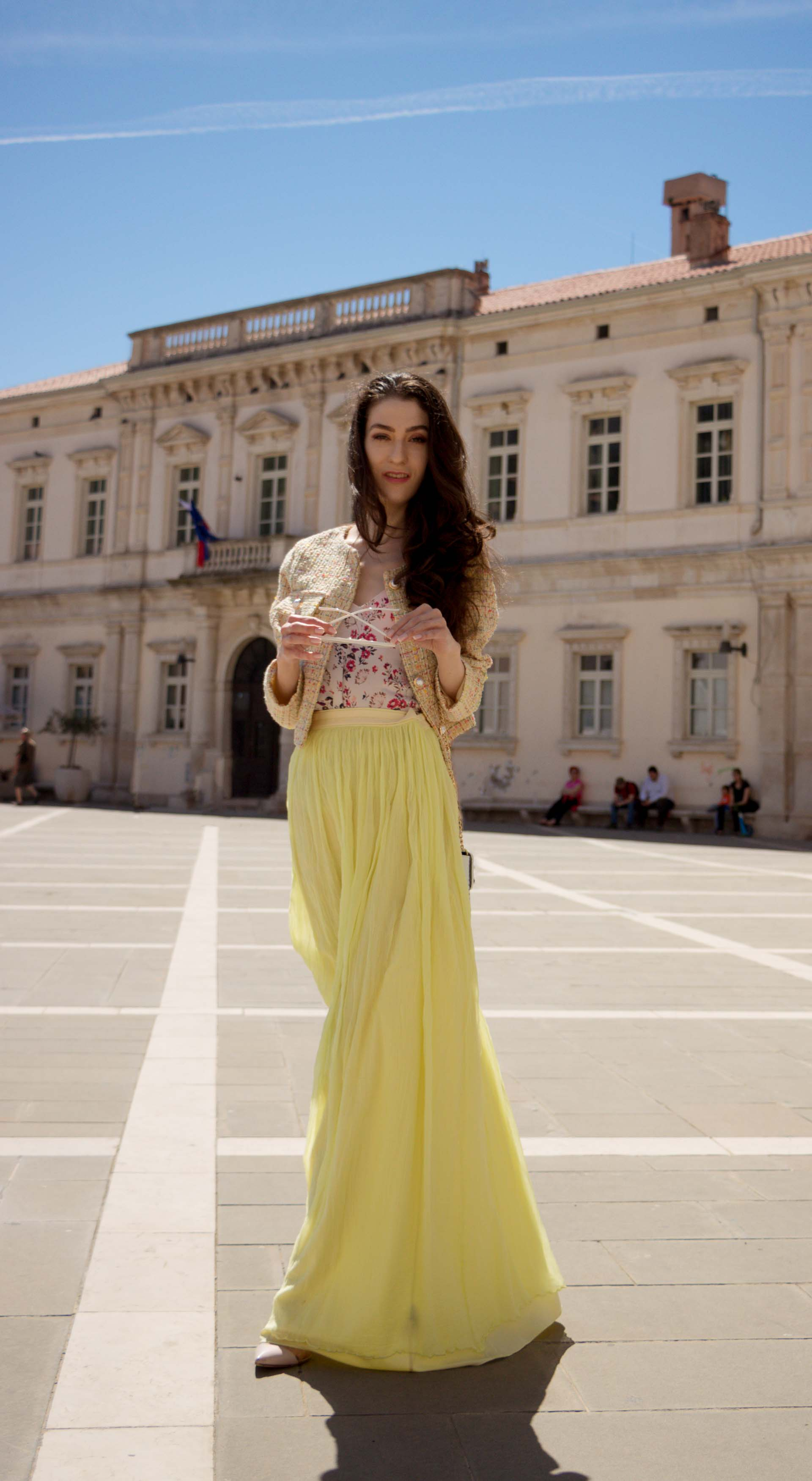 Veronika Lipar Fashion Blogger of Brunette from Wall Street wearing maxi yellow tulle skirt from Needle & Thread, short yellow tweed jacket from Storets, floral silk top, blush Gianvito Rossi plexi pumps, white shoulder bag, Lespecs white cat eye sunglasses