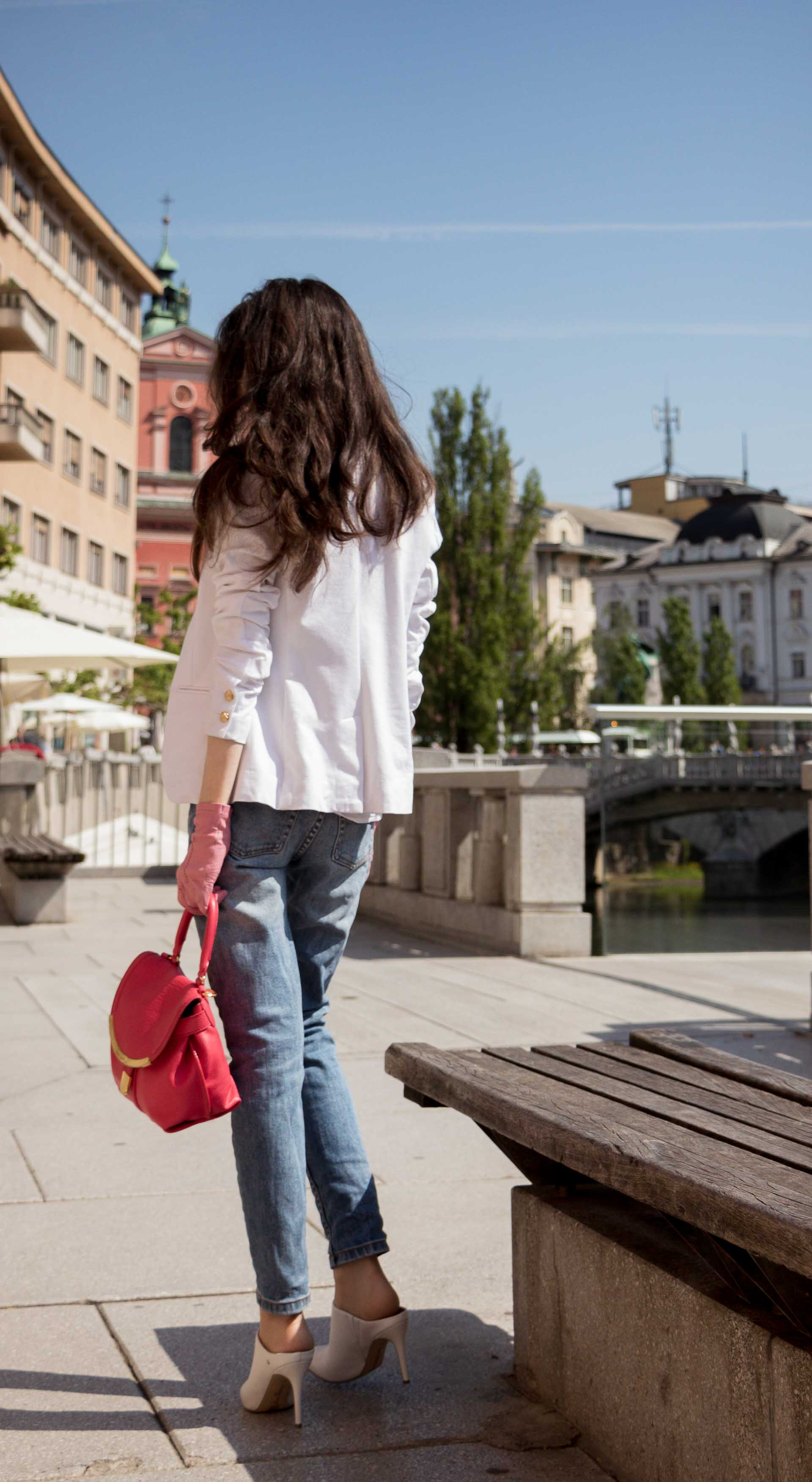 Veronika Lipar Fashion Blogger of Brunette from Wall Street wearing white mules, blue A.P.C. mom jeans, white fringe blouse, white blazer, pink gloves, pink top handle bag