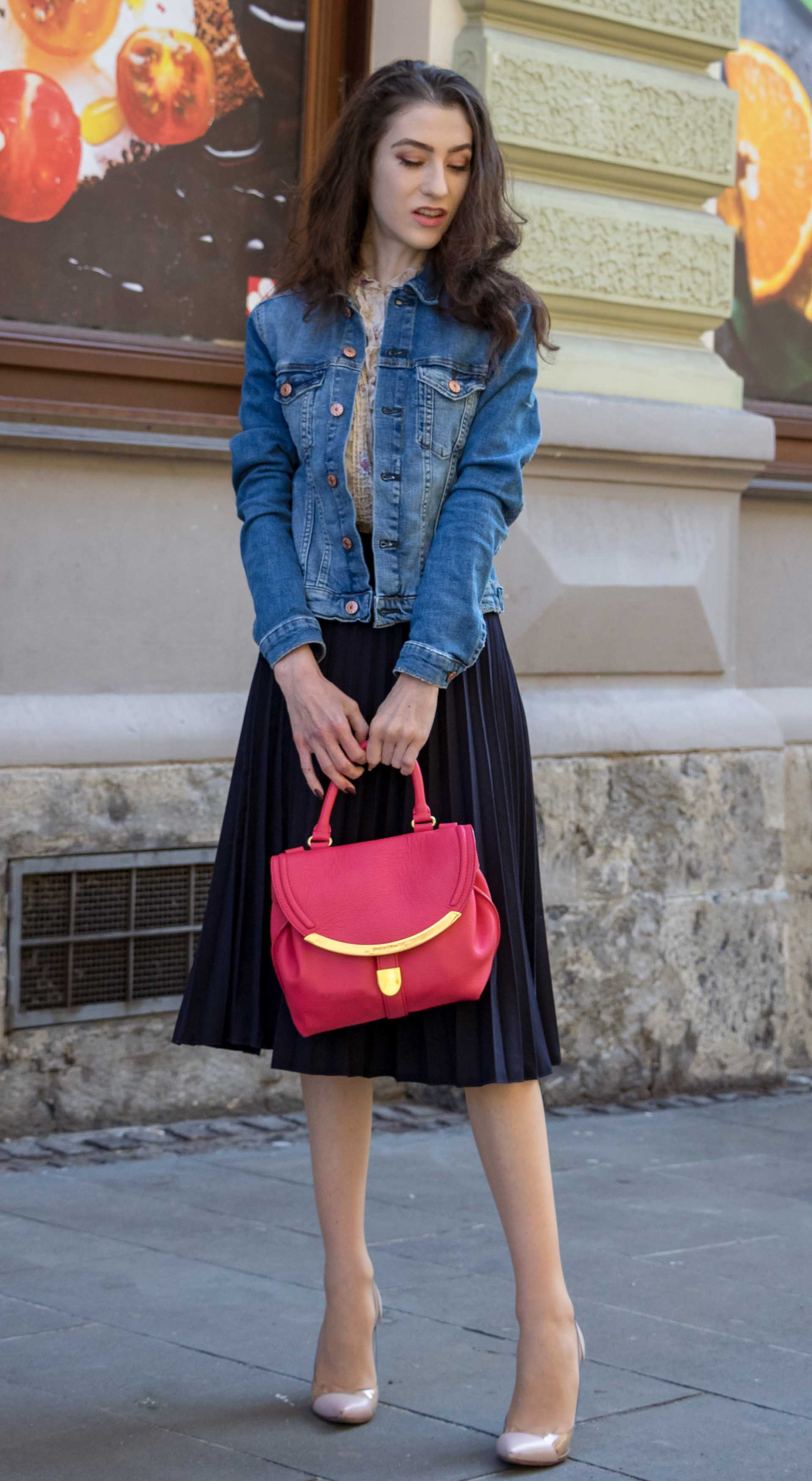 Veronika Lipar Fashion Blogger of Brunette from Wall Street wearing H&M denim jacket, floral blouse, midi pleated skirt, Gianvito Rossi plexi pumps, pink top handle bag on cold summer morning before going to brunch with friends