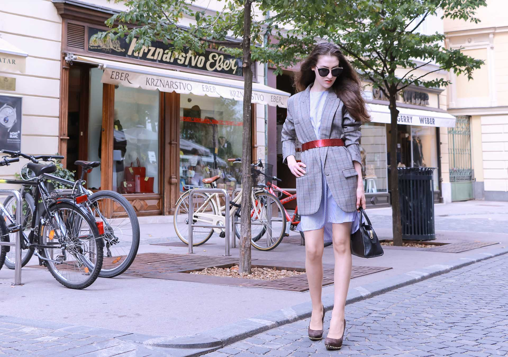 Veronika Lipar Fashion Blogger of Brunette from Wall Street wearing Erika Cavallini plaid blazer, blue striped shirtdress, red belt, brown court shoes, black top handle bag, Le Specs black shades on the street