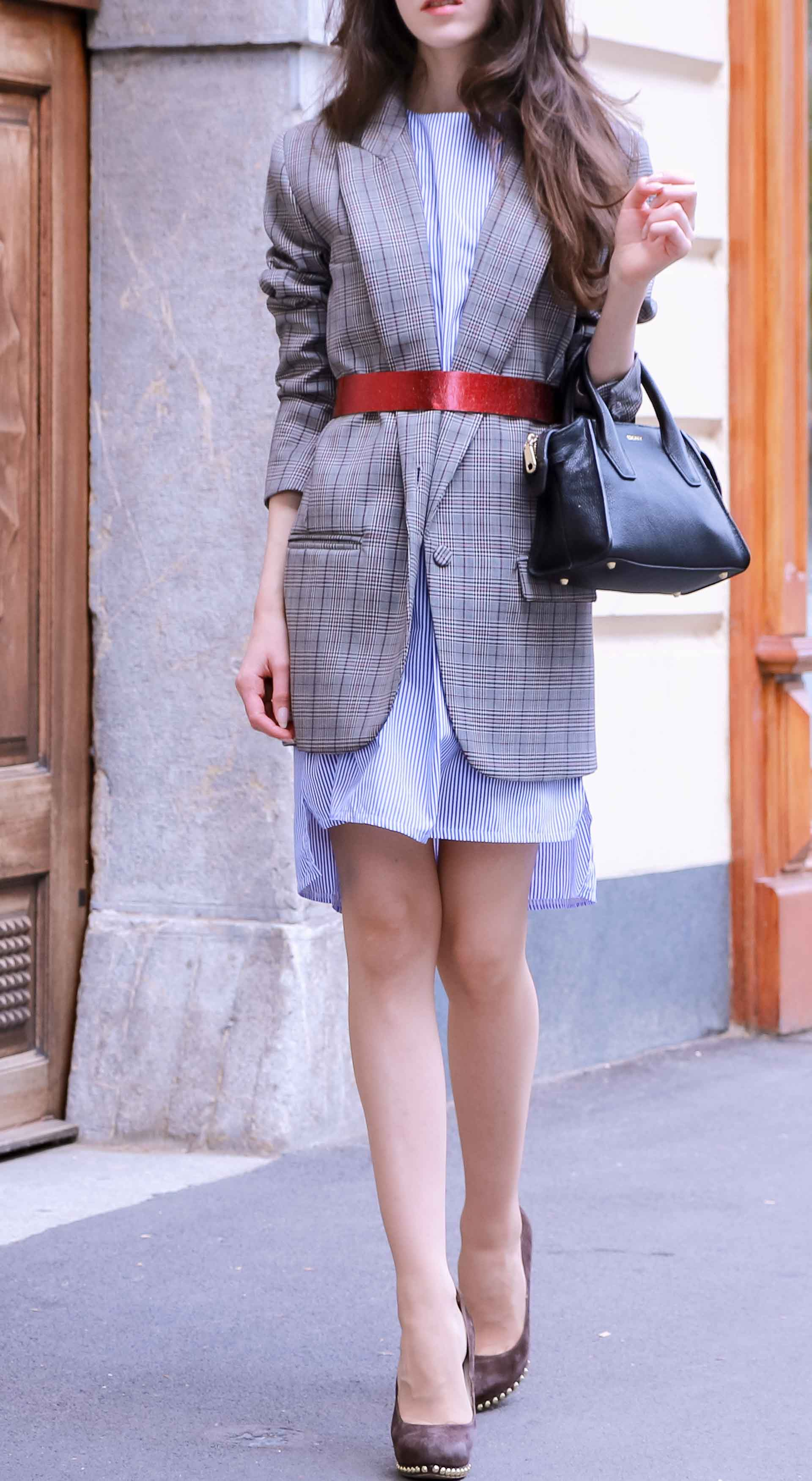 Veronika Lipar Fashion Blogger of Brunette from Wall Street dressed in Erika Cavallini plaid blazer, blue striped shirtdress, red belt, brown court shoes, black top handle bag, Le Specs black sunglasses