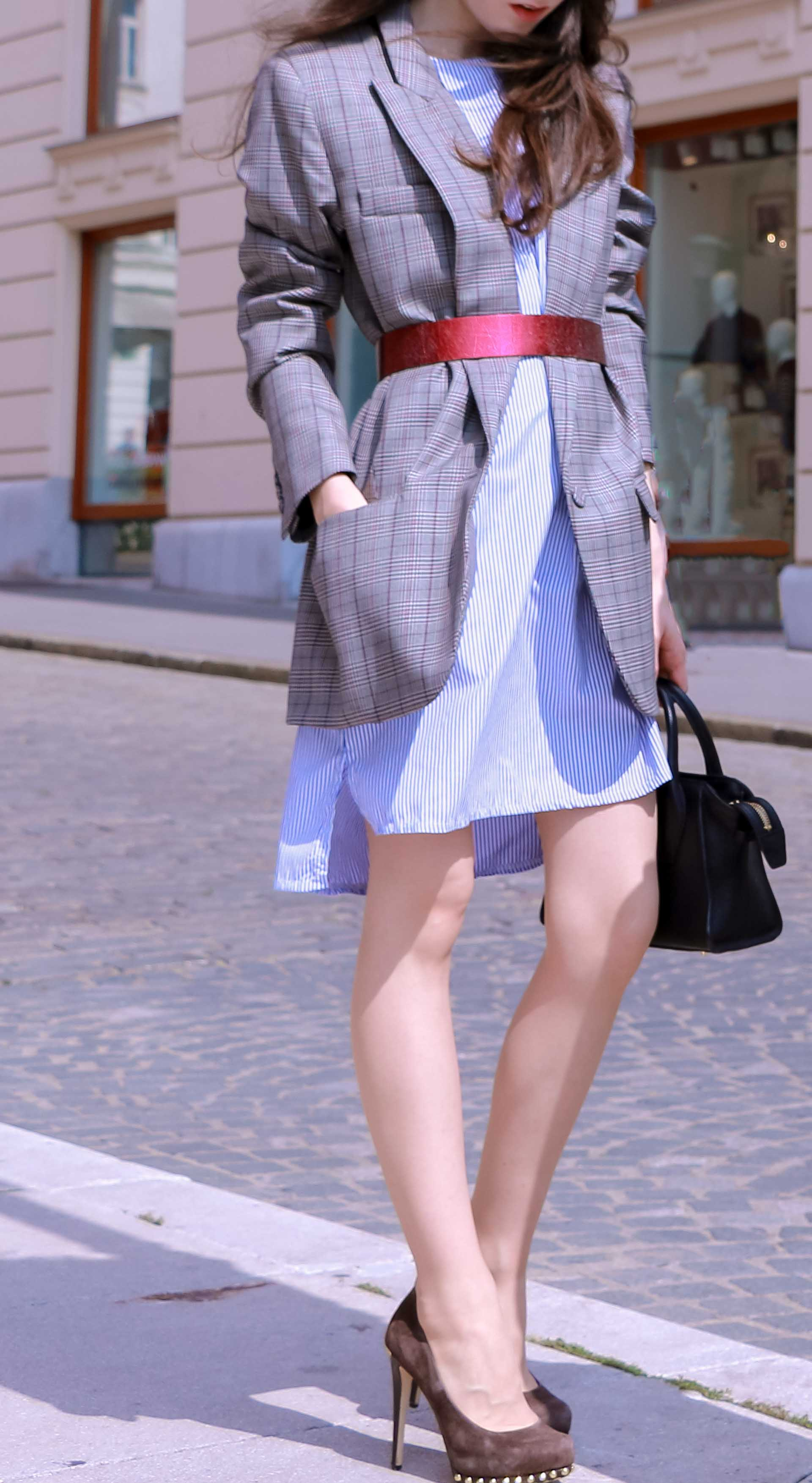 Veronika Lipar Fashion Blogger of Brunette from Wall Street dressed in Erika Cavallini plaid blazer, blue striped shirtdress, red belt, brown court shoes, black top handle bag in Ljubljana