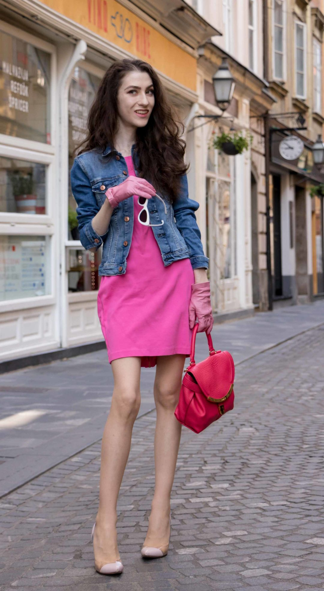 Veronika Lipar Fashion Blogger of Brunette from Wall Street wearing H&M denim jacket, pink cocktail dress, blush Gianvito Rossi plexi pumps, pink Forzieri gloves, See by Chloé pink top handle bag, Adam Selman x Le Specs white cat eye Lolita sunglasses