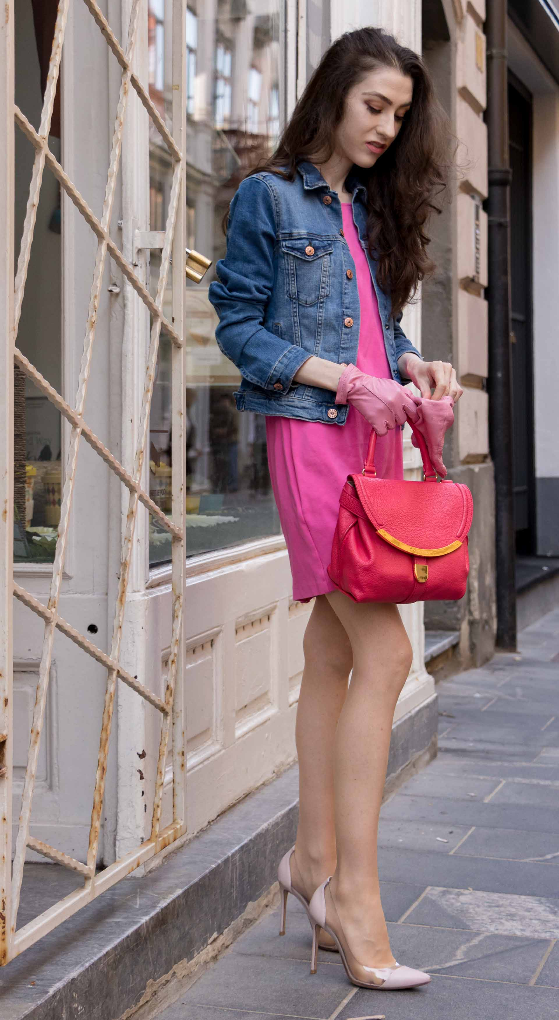 Veronika Lipar Fashion Blogger of Brunette from Wall Street dressed in H&M denim jacket, pink bodycon dress, blush Gianvito Rossi plexi pumps, pink Forzieri gloves, See by Chloé pink top handle bag, Adam Selman x Le Specs white cat eye Lolita sunglasses