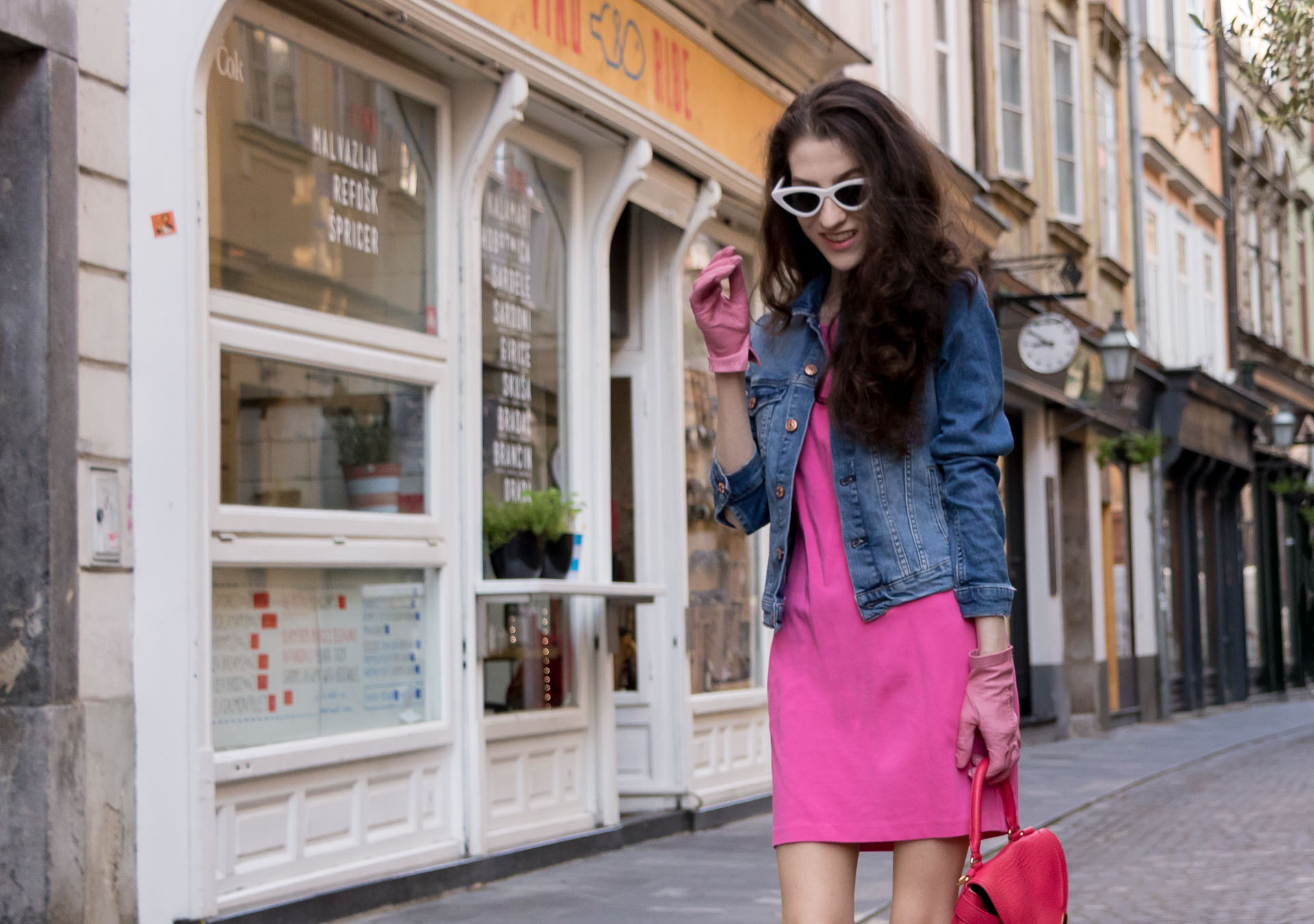 Veronika Lipar Fashion Blogger of Brunette from Wall Street dressed in H&M denim jacket, pink cocktail dress, blush Gianvito Rossi plexi pumps, pink Forzieri gloves, See by Chloé pink top handle bag, Adam Selman x Le Specs white cat eye Lolita sunglasses
