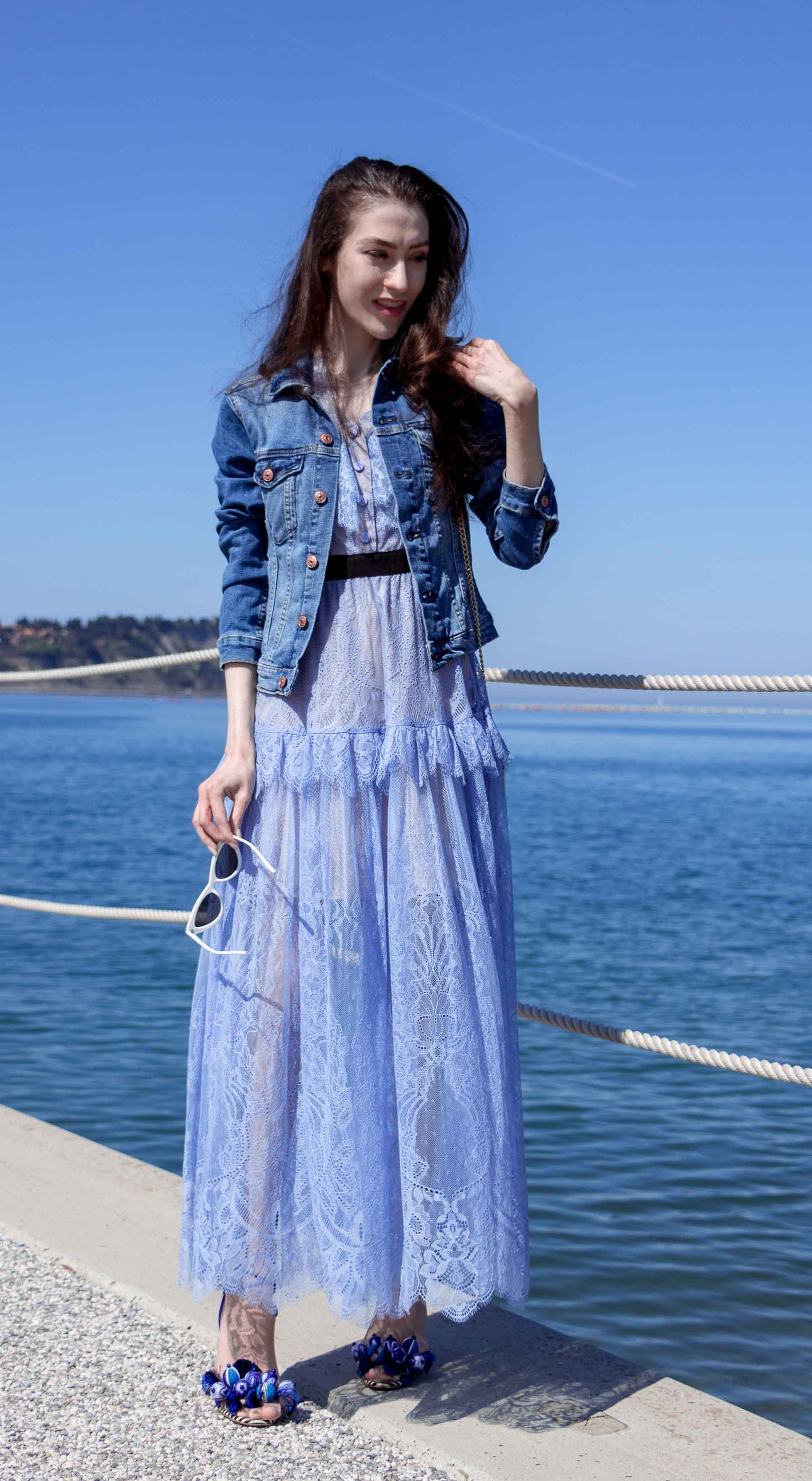 Veronika Lipar Fashion Blogger of Brunette from Wall Street wearing blue off the shoulder midi lace dress from Self-Portrait, H&M blue denim jacket, white chain shoulder bag, Aquazzura blue pom pom tassels sandals, white Lolita cat-eye sunglasses for romantic summer date
