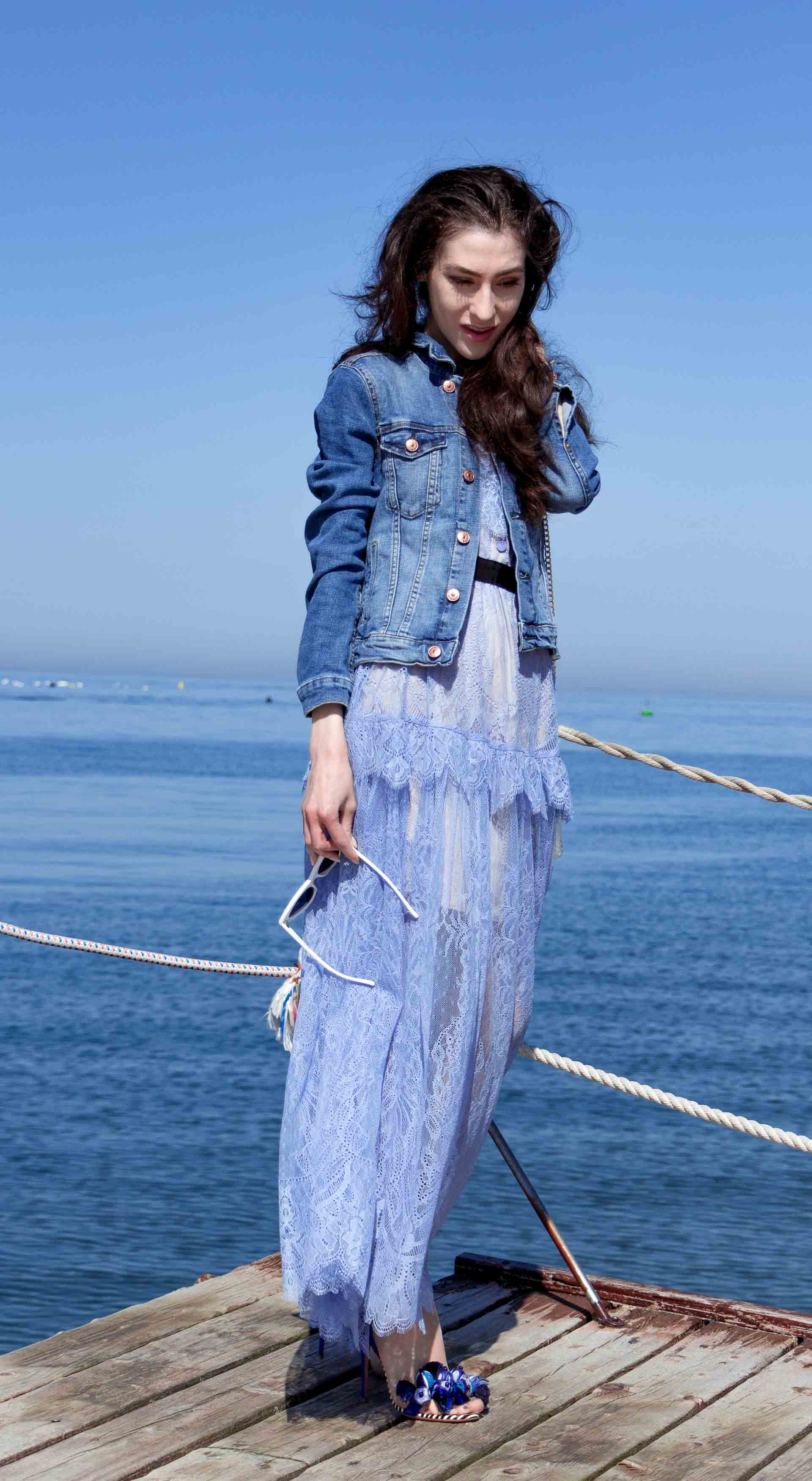 Veronika Lipar Fashion Blogger of Brunette from Wall Street dressed in blue off the shoulder midi lace dress from Self-Portrait, H&M blue denim jacket, white chain shoulder bag, Aquazzura blue pom pom tassels sandals, white Lolita cat-eye sunglasses on romantic summer date