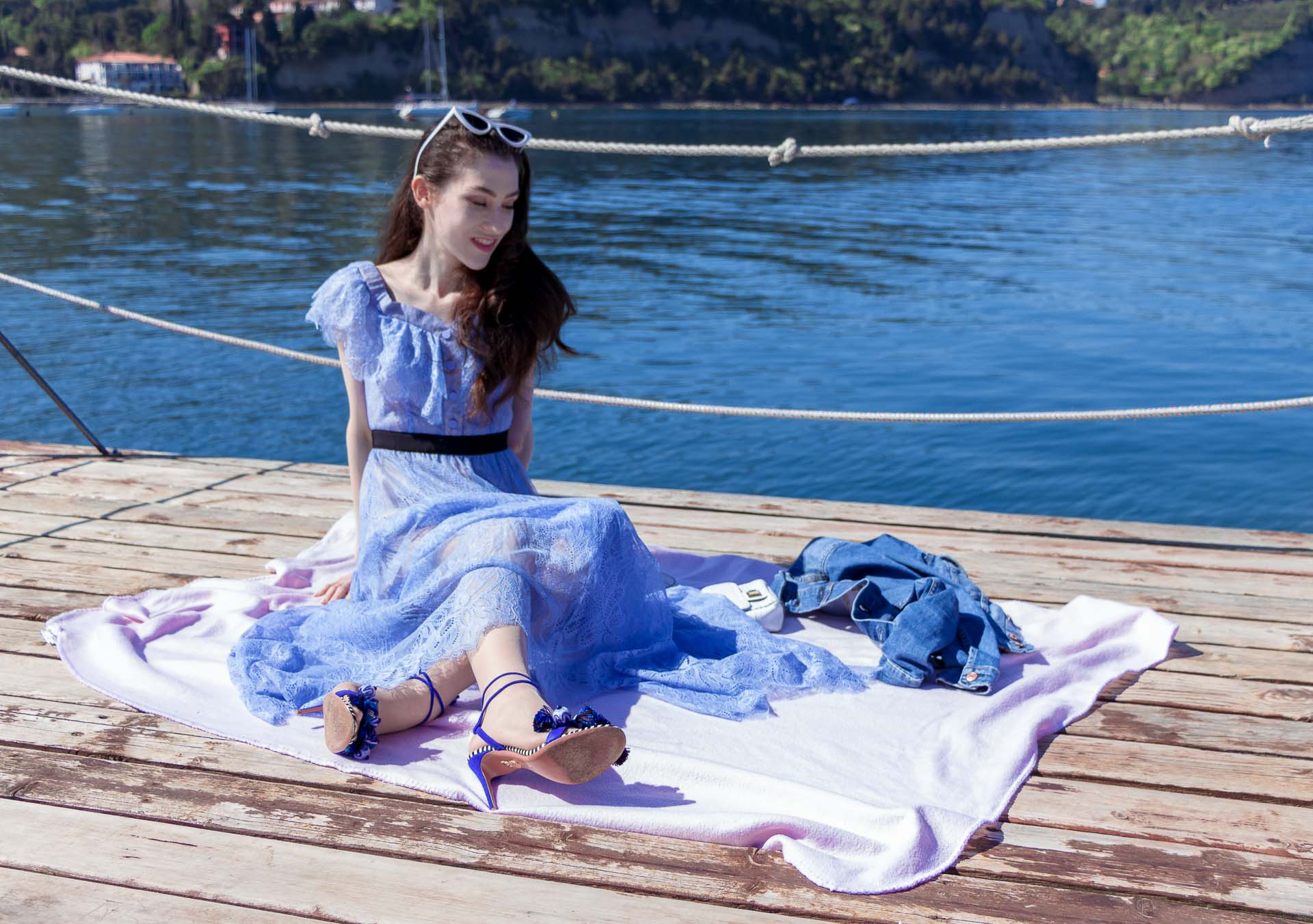 Veronika Lipar Fashion Blogger of Brunette from Wall Street dressed in blue off the shoulder midi lace dress from Self-Portrait, white chain shoulder bag, Aquazzura blue pom pom tassels sandals, white Lolita cat-eye sunglasses for romantic summer date picnic