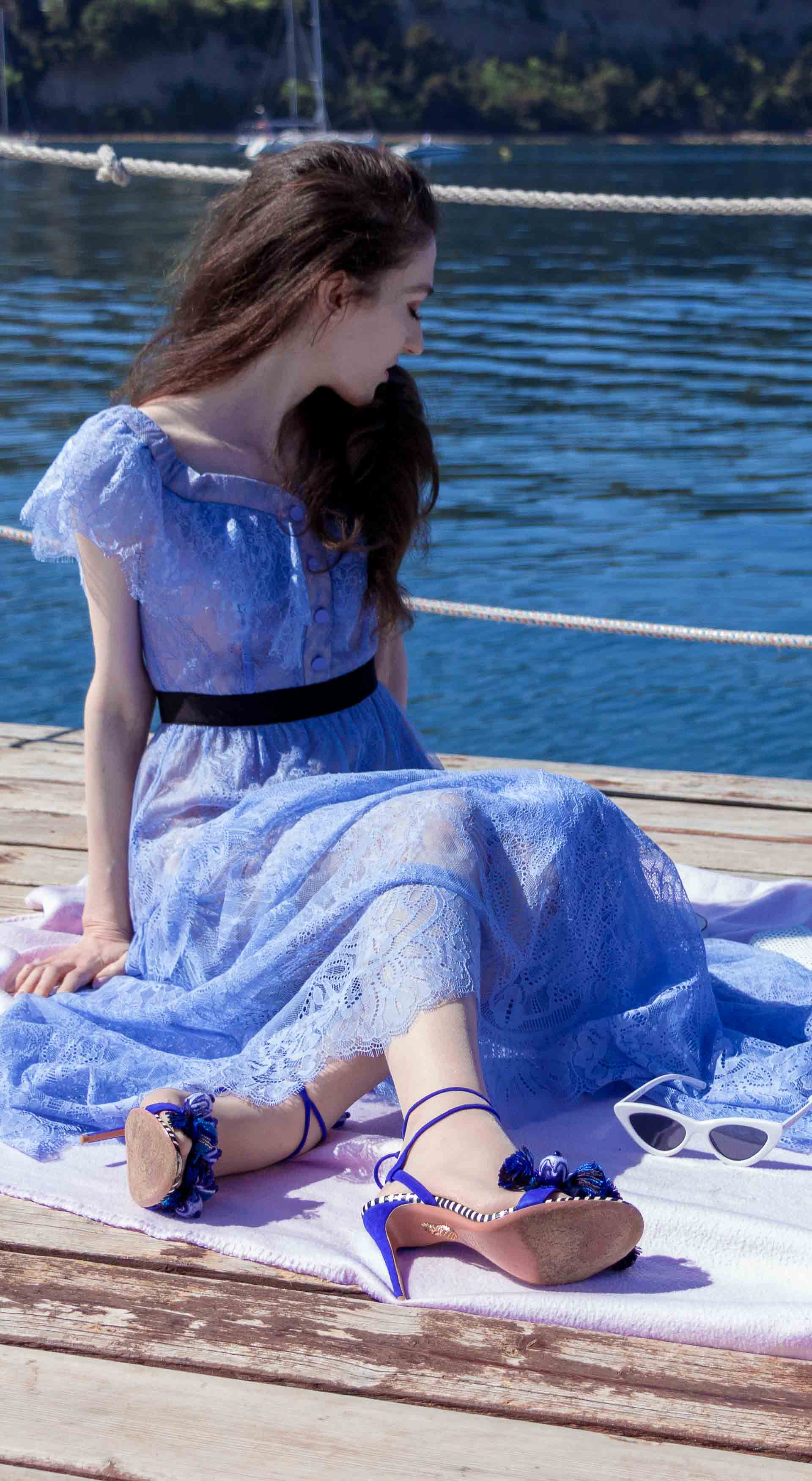 Veronika Lipar Fashion Blogger of Brunette from Wall Street wearing blue off the shoulder midi lace dress from Self-Portrait, H&M blue denim jacket, white chain shoulder bag, Aquazzura blue pom pom tassels sandals, white Lolita cat-eye sunglasses for romantic summer date picnic