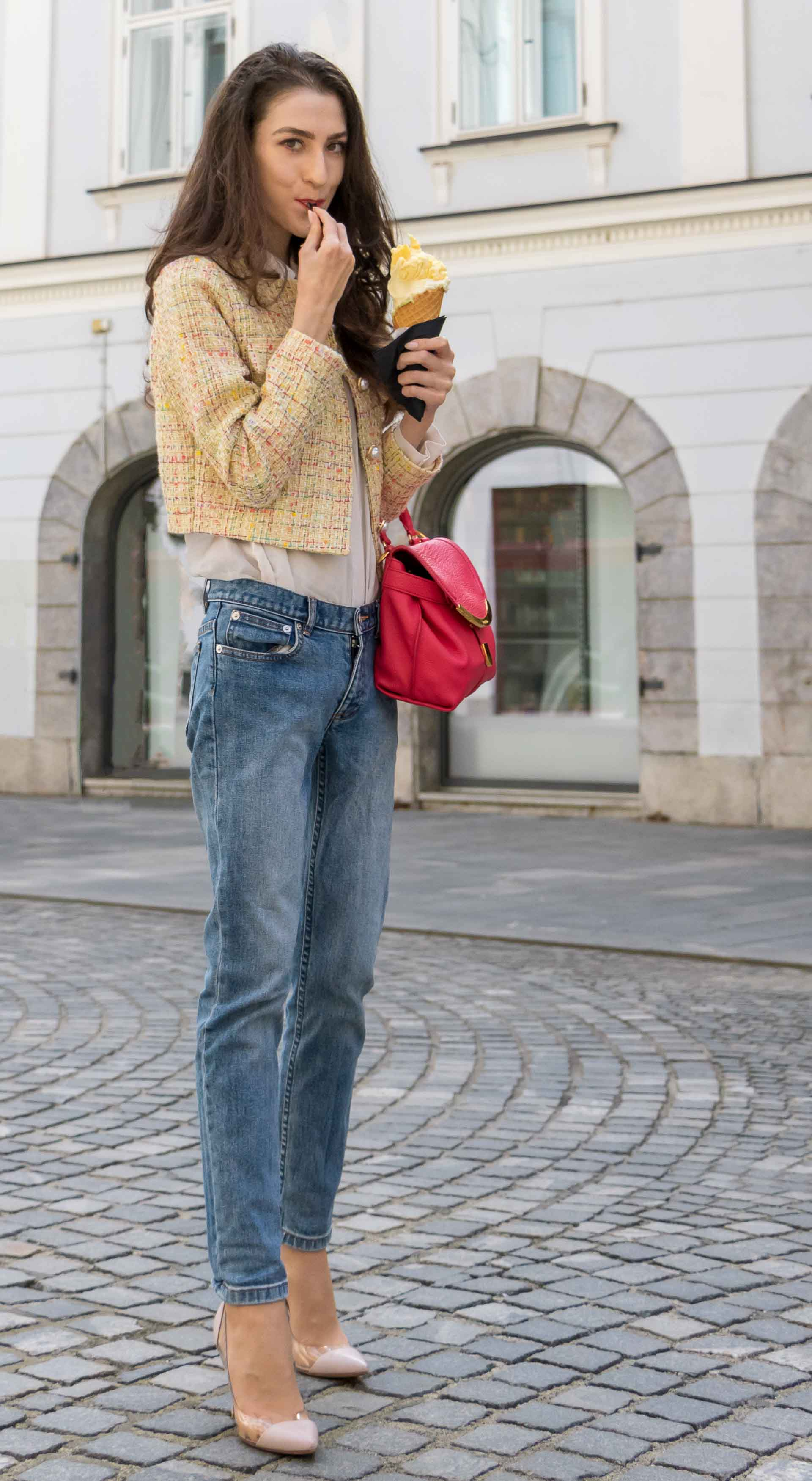 Veronika Lipar Fashion Blogger of Brunette from Wall Street wearing chic casual everyday spring outfit, the yellow tweed jacket from Storets, blue jeans from A.P.C., blush Gianvito Rossi plexi pumps, pink top handle bag and organza white shirt while eating ice cream in a cone