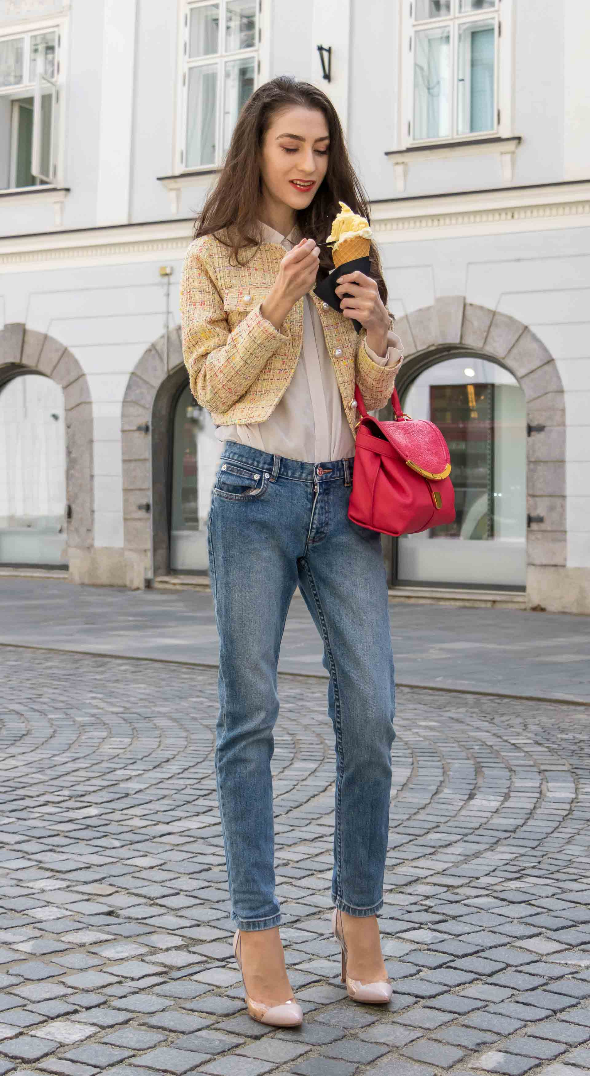 Veronika Lipar Fashion Blogger of Brunette from Wall Street dressed in chic casual everyday spring outfit, the yellow tweed jacket from Storets, blue jeans from A.P.C., blush Gianvito Rossi plexi pumps, pink top handle bag and organza white shirt on the street eating cone ice cream