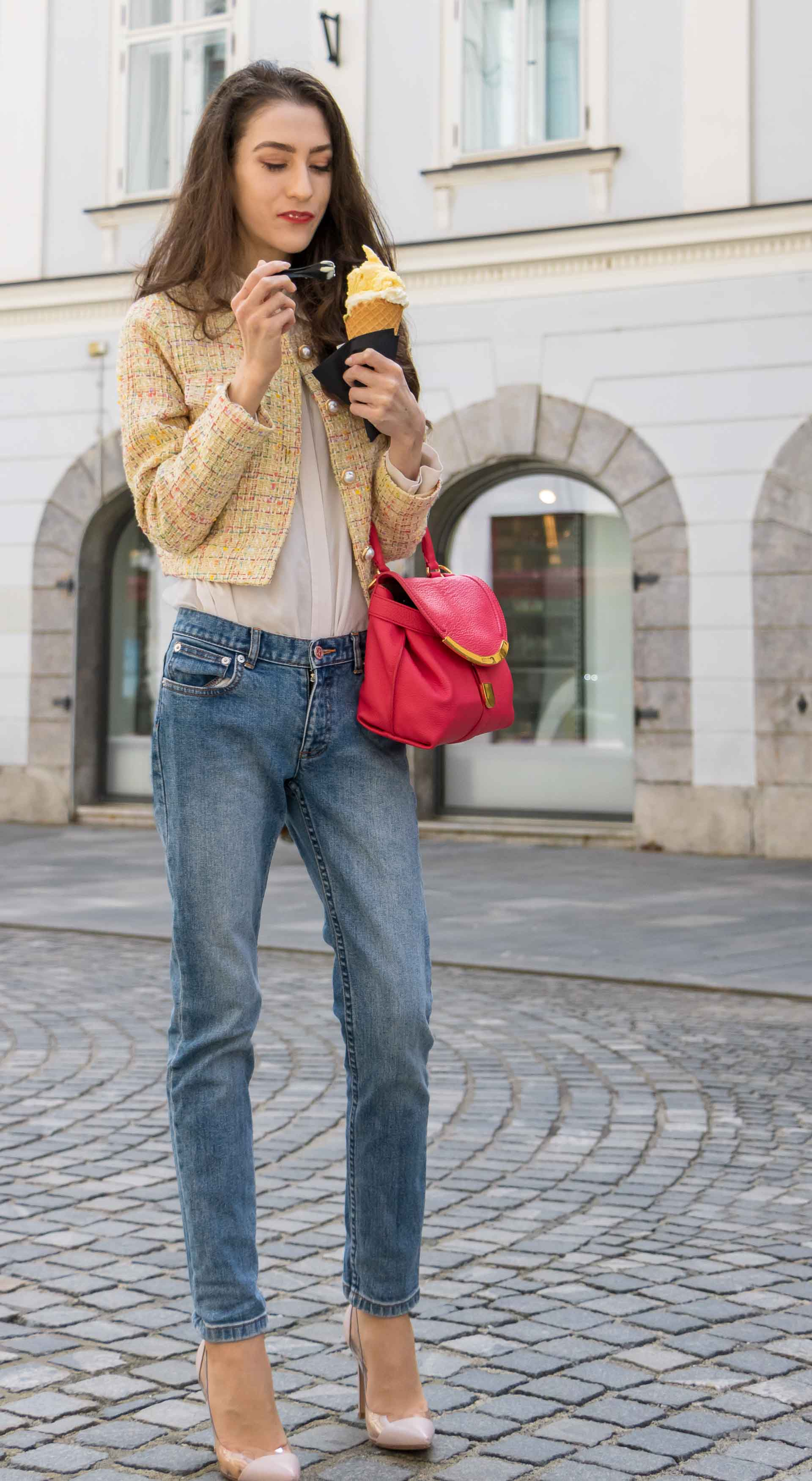 Veronika Lipar Fashion Blogger of Brunette from Wall Street dressed in chic casual everyday spring outfit, the yellow tweed jacket from Storets, blue jeans from A.P.C., blush Gianvito Rossi plexi pumps, pink top handle bag and organza white shirt on the street eating ice cream