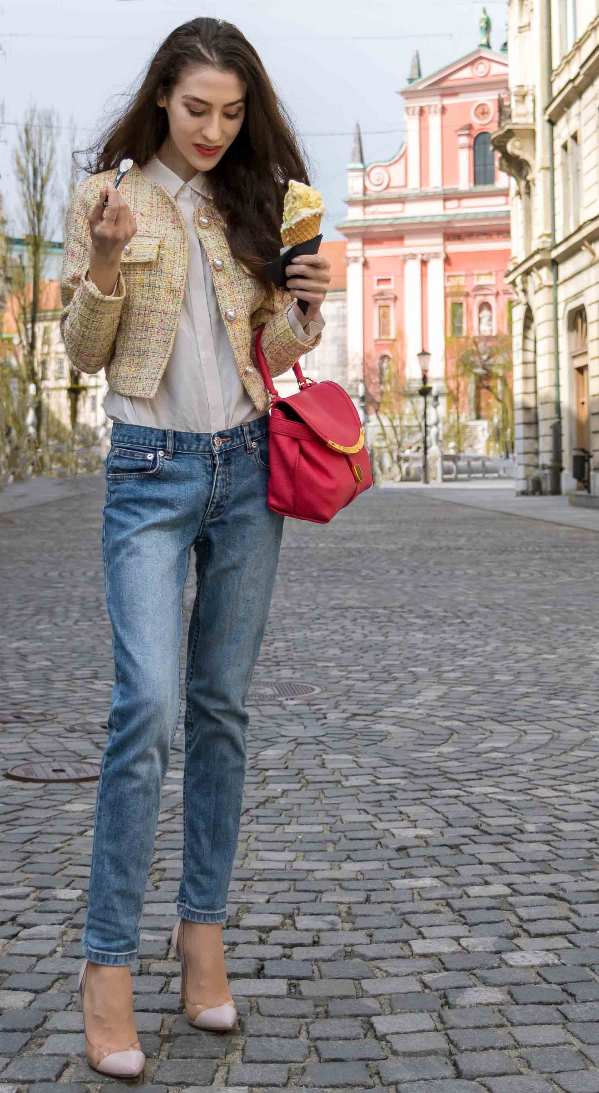 Veronika Lipar Fashion Blogger of Brunette from Wall Street dressed in chic casual everyday spring outfit, the yellow tweed jacket from Storets, blue jeans from A.P.C., blush Gianvito Rossi plexi pumps, pink top handle bag and organza white shirt on the street licking cone ice cream