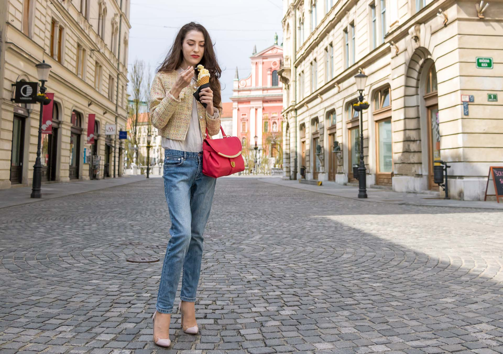 Veronika Lipar Fashion Blogger of Brunette from Wall Street wearing chic casual everyday spring outfit, the yellow tweed jacket from Storets, blue jeans from A.P.C., pink top handle bag and organza white shirt eating ice cream on the street