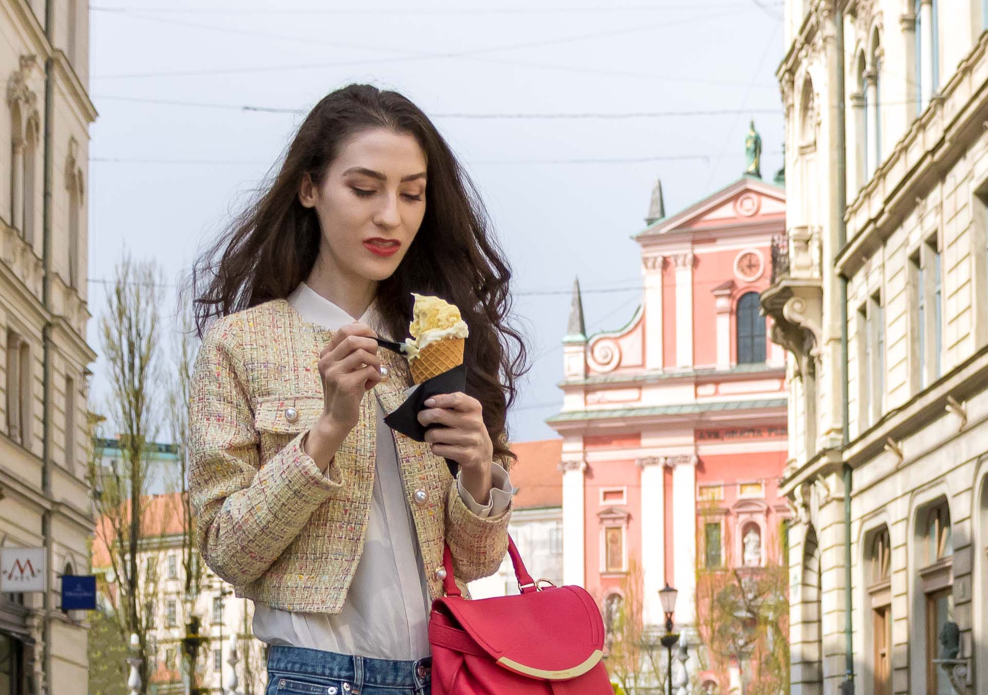Veronika Lipar Fashion Blogger of Brunette from Wall Street wearing chic casual everyday spring outfit, the yellow tweed jacket from Storets, blue jeans from A.P.C., pink top handle bag and organza white shirt on the street eating ice cream