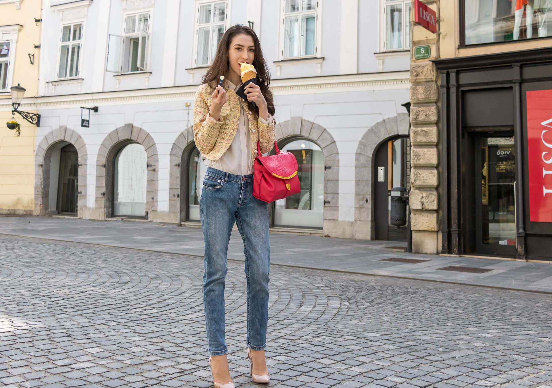 Veronika Lipar Fashion Blogger of Brunette from Wall Street wearing chic casual everyday spring outfit, the yellow tweed jacket from Storets, blue jeans from A.P.C., blush Gianvito Rossi plexi pumps, pink top handle bag and organza white shirt on the street licking ice cream