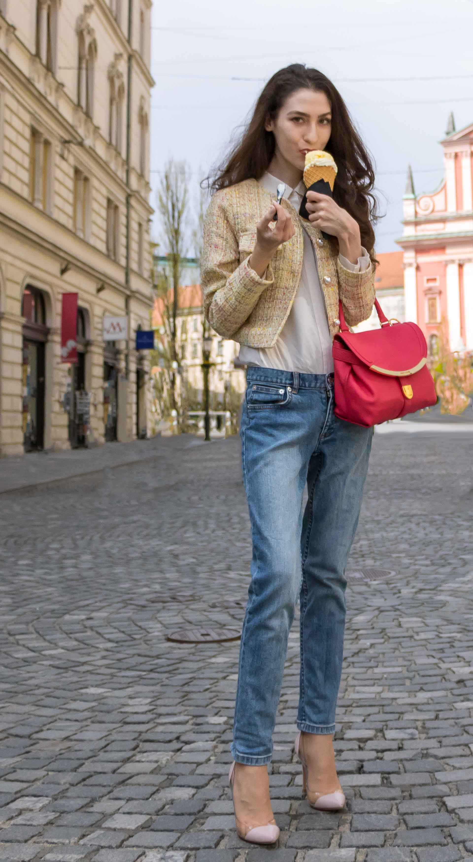 Veronika Lipar Fashion Blogger of Brunette from Wall Street dressed in chic casual everyday spring outfit, the yellow tweed jacket from Storets, blue jeans from A.P.C., blush Gianvito Rossi plexi pumps, pink top handle bag and organza white shirt on the street licking ice cream
