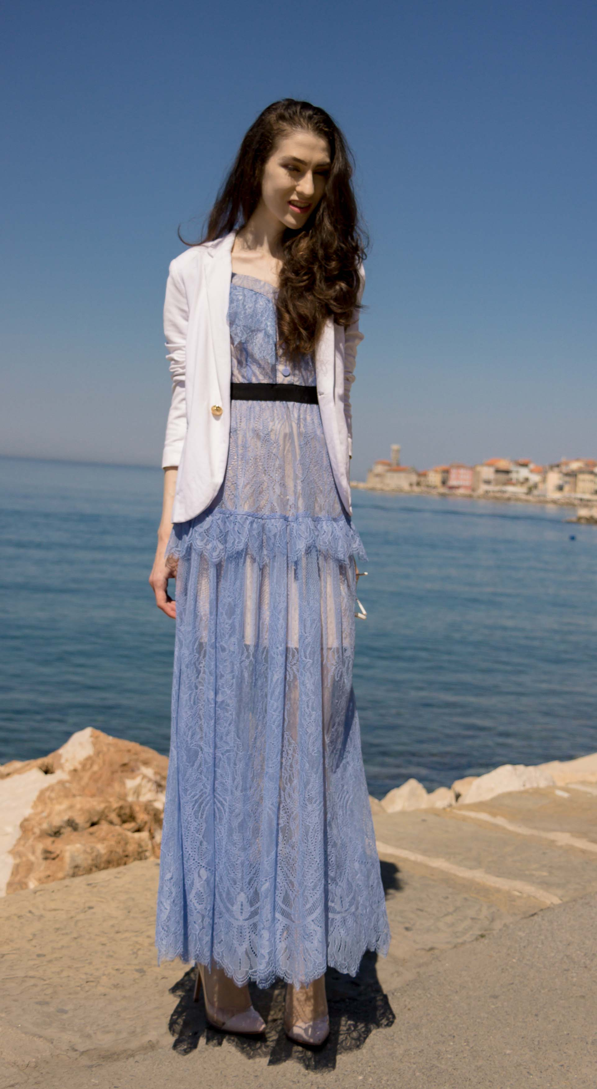 Veronika Lipar Fashion Blogger of Brunette from Wall Street dressed in Self-Portrait blue lace midi dress, white single button blazer, blush Gianvito Rossi plexi pumps, white shoulder bag, Lespecs white cat eye sunglasses for a wedding by the sea