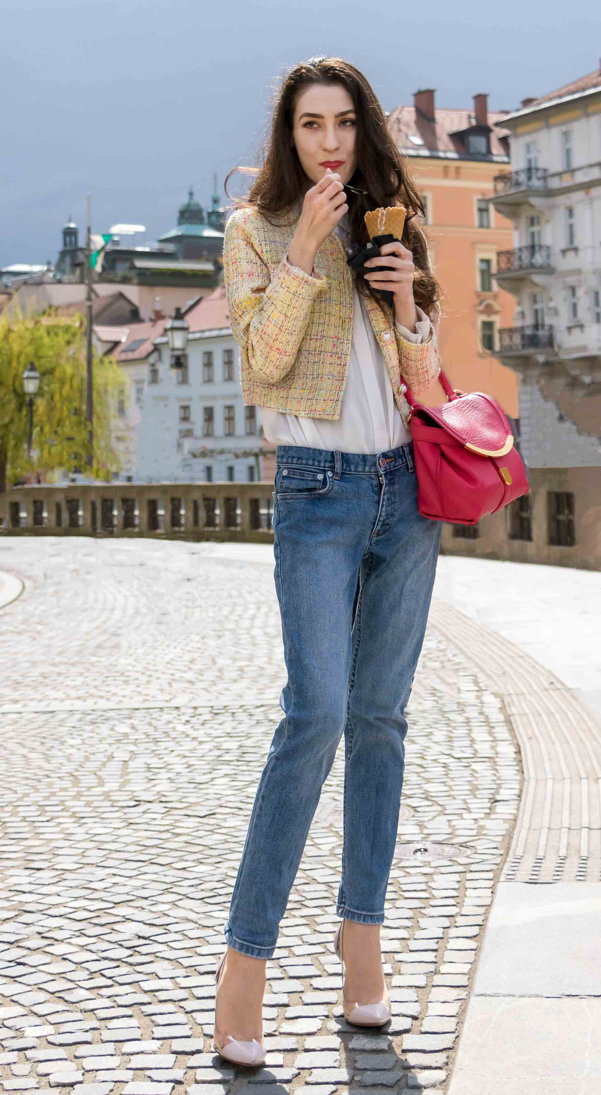 Veronika Lipar Fashion Blogger of Brunette from Wall Street dressed in chic casual everyday spring outfit, the yellow tweed jacket from Storets, blue jeans from A.P.C., blush Gianvito Rossi plexi pumps, pink top handle bag and organza white shirt on the street licking ice cream cone
