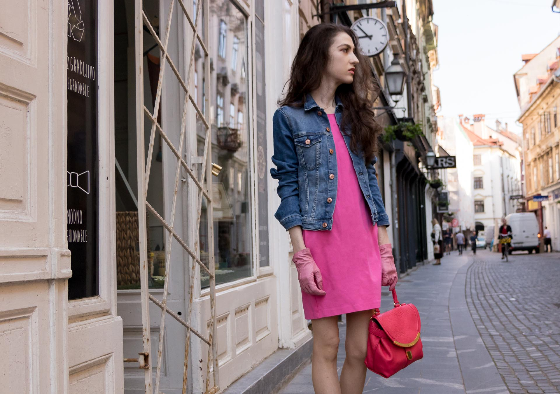 Veronika Lipar Fashion Blogger of Brunette from Wall Street dressed in H&M denim jacket, pink summer dress, blush Gianvito Rossi plexi pumps, pink Forzieri gloves, See by Chloé pink top handle bag, Adam Selman x Le Specs white cat eye Lolita sunglasses