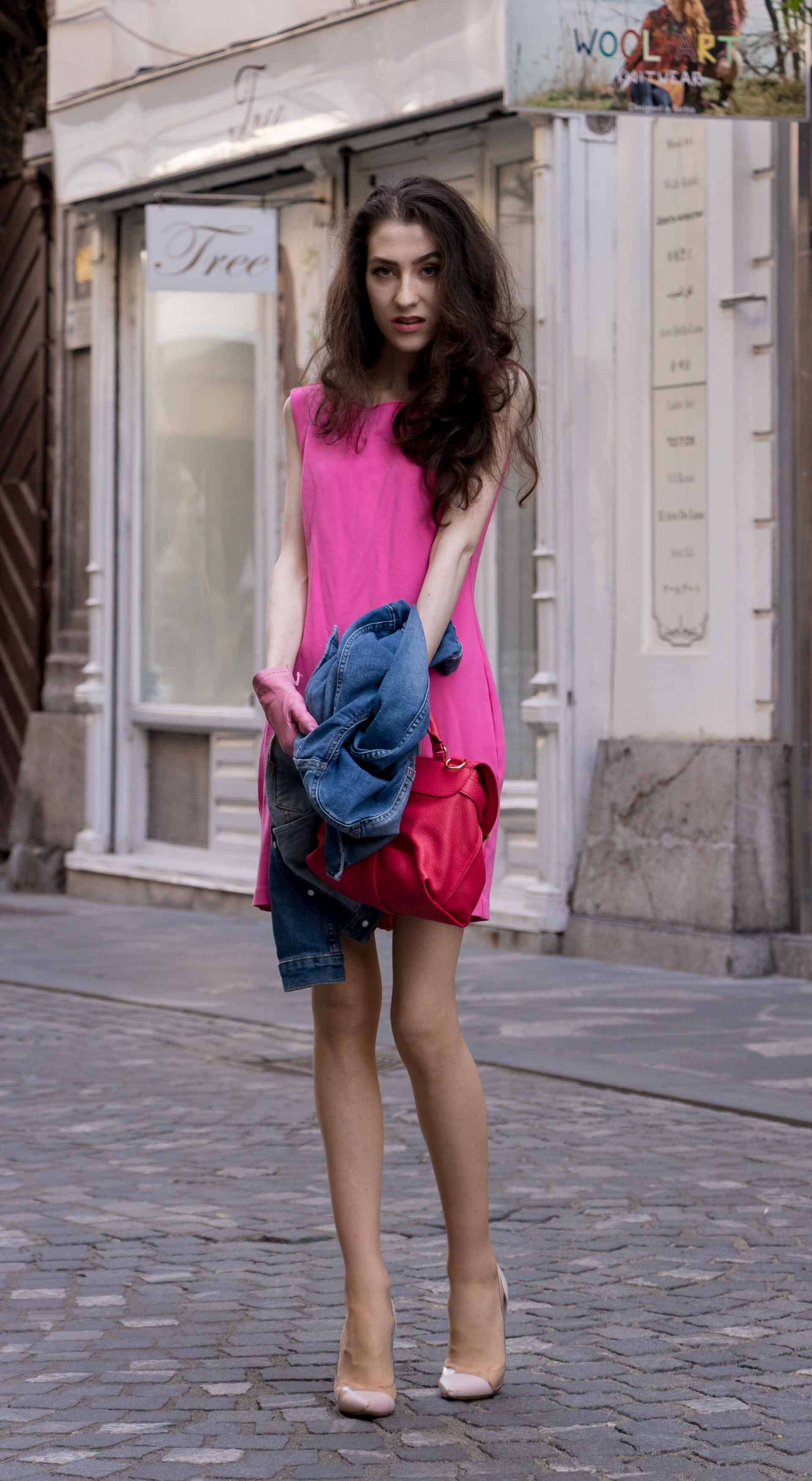 Veronika Lipar Fashion Blogger of Brunette from Wall Street wearing H&M denim jacket, pink summer dress, blush Gianvito Rossi plexi pumps, pink Forzieri gloves, See by Chloé pink top handle bag, Adam Selman x Le Specs white cat eye Lolita sunglasses while standing on the street in Ljubljana