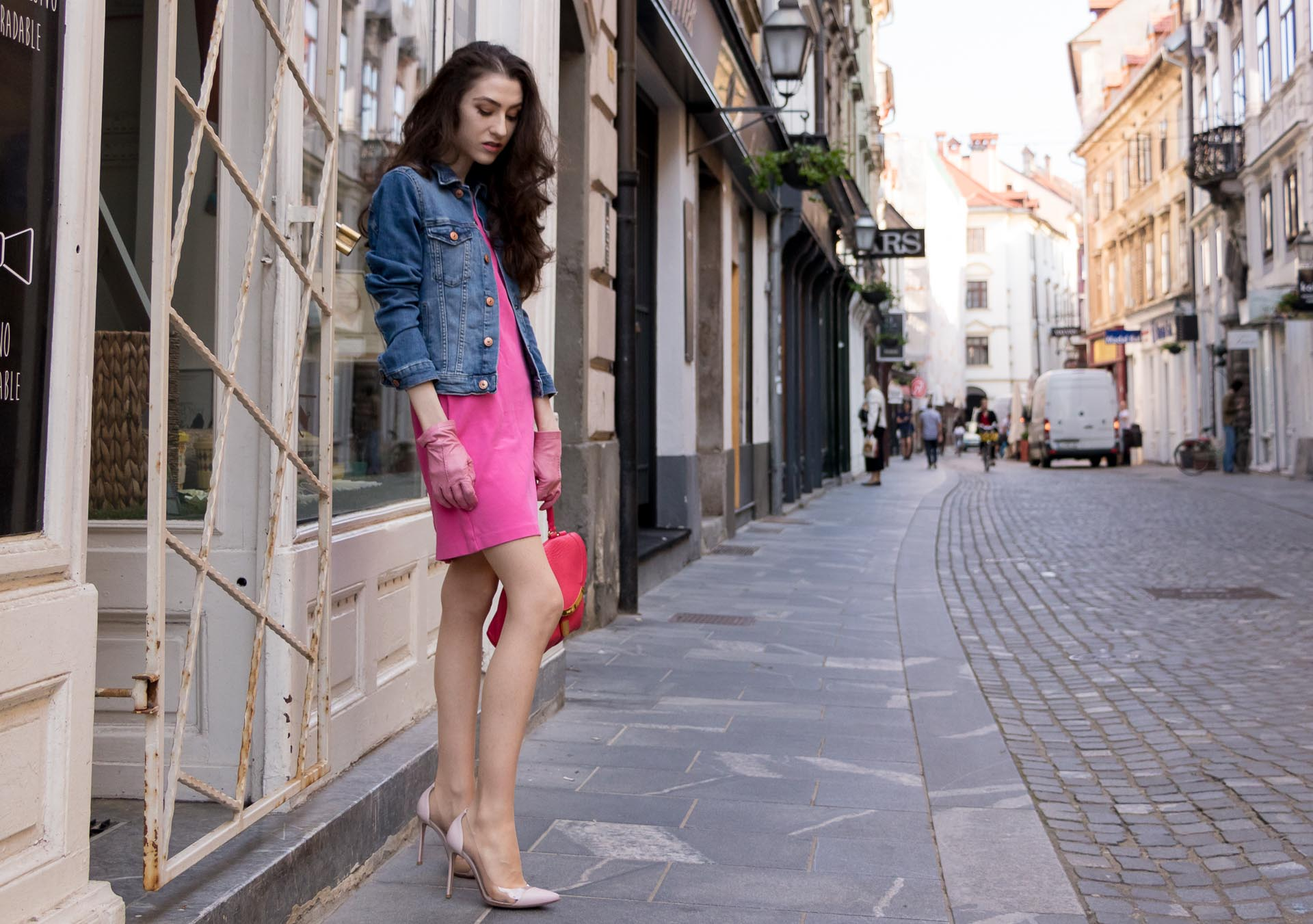 Veronika Lipar Fashion Blogger of Brunette from Wall Street dressed in H&M denim jacket, pink shift cady dress, blush Gianvito Rossi plexi pumps, pink Forzieri gloves, See by Chloé pink top handle bag, Adam Selman x Le Specs white cat eye Lolita sunglasses