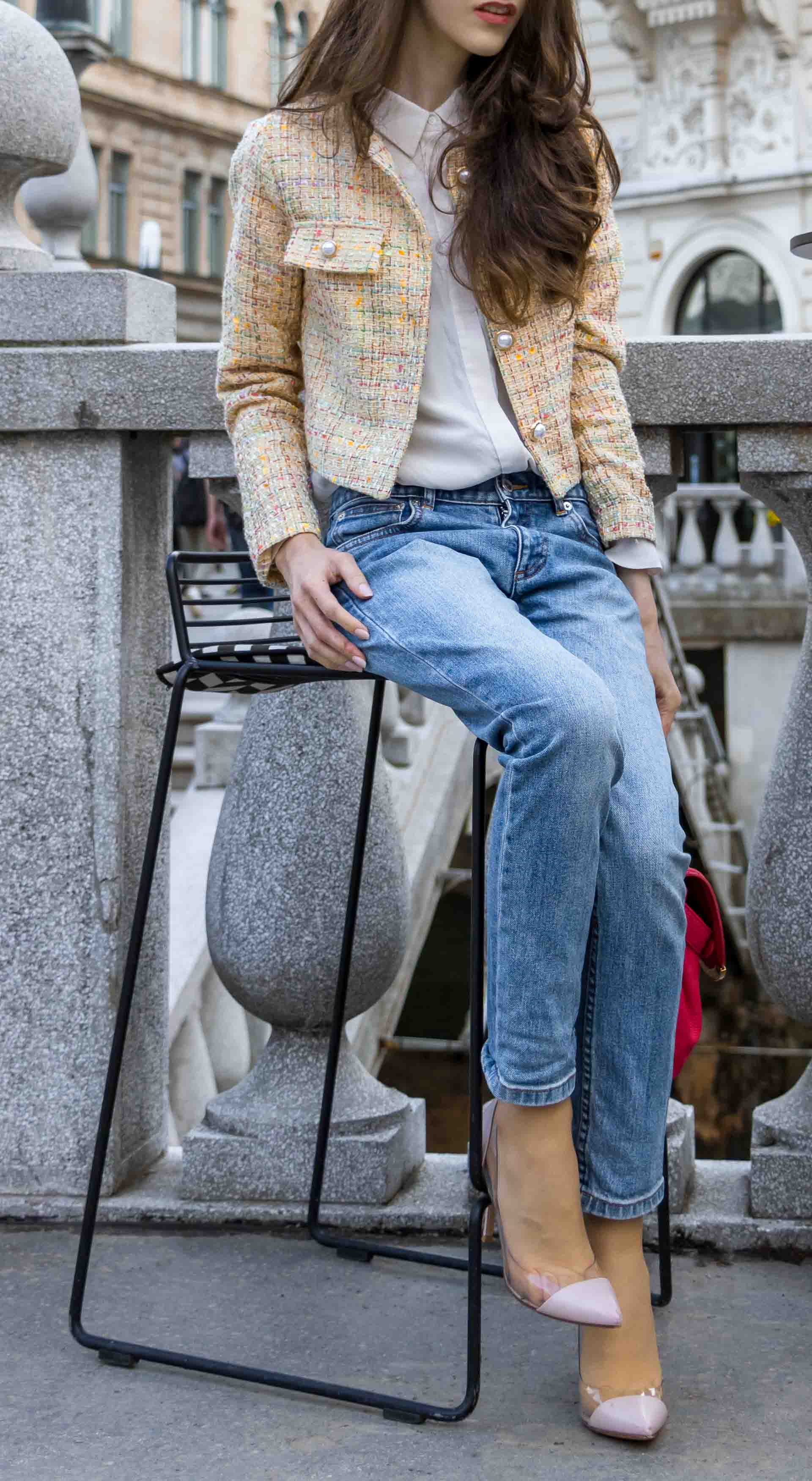 Veronika Lipar Fashion Blogger of Brunette from Wall Street dressed in chic casual everyday spring outfit, the yellow tweed jacket from Storets, blue jeans from A.P.C., blush Gianvito Rossi plexi pumps, pink top handle bag and organza white sitting on a bar stole outdoors