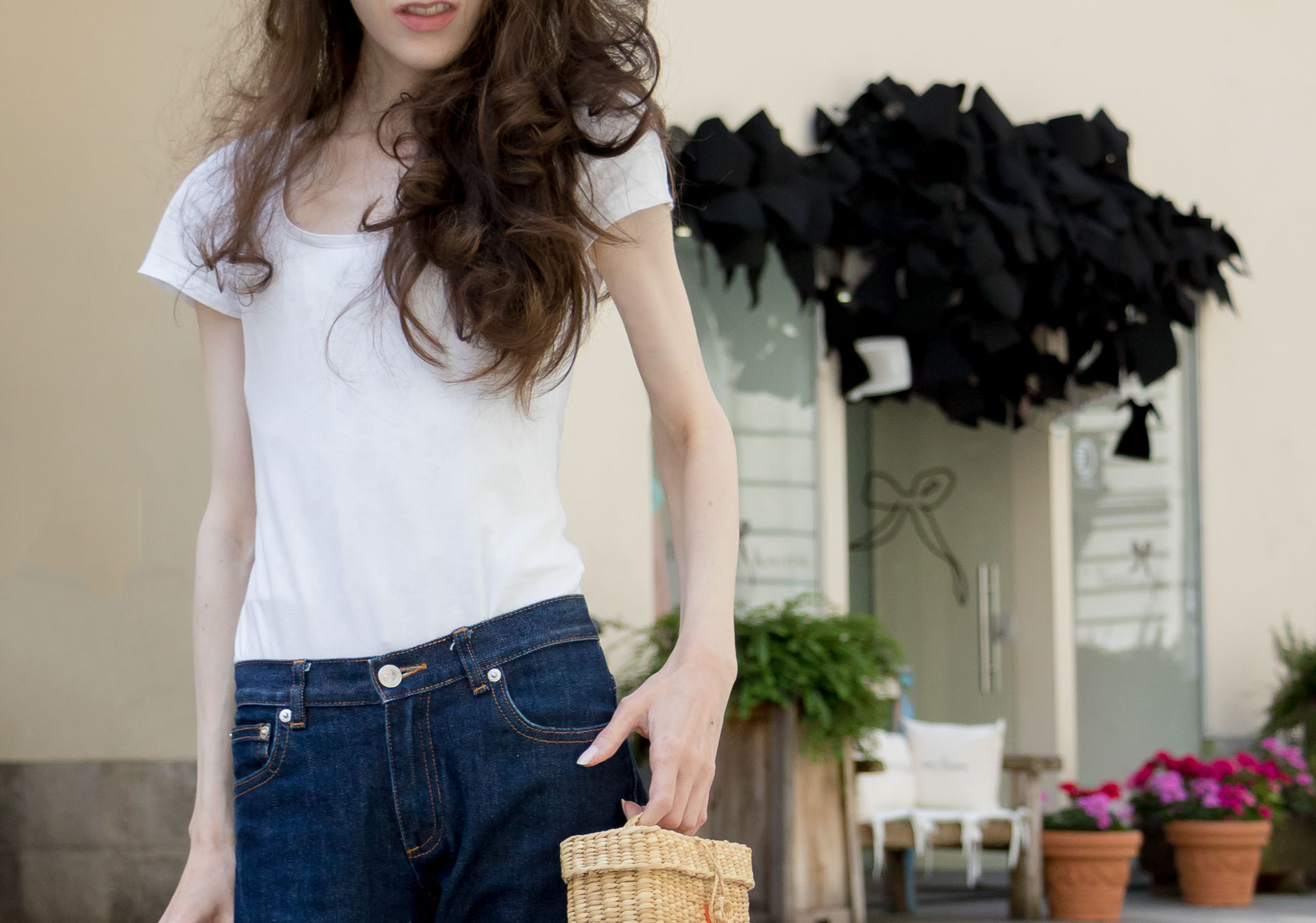 Veronika Lipar Fashion Editor of Brunette from Wall Street dressed in summer basics dark blue tapered jeans from A.P.C., H&M white T-shirt, Nannacay basket bag