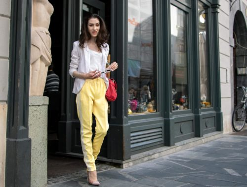 Veronika Lipar Fashion Blogger of Brunette from Wall Street wearing white blazer, white H&M t-shirt, yellow Addidas track pants, See by Chloé pink top handle bag, Adam Selman x Le Specs white cat eye Lolita sunglasses, pink blush Gianvito Rossi plexi pumps on the street in the morning