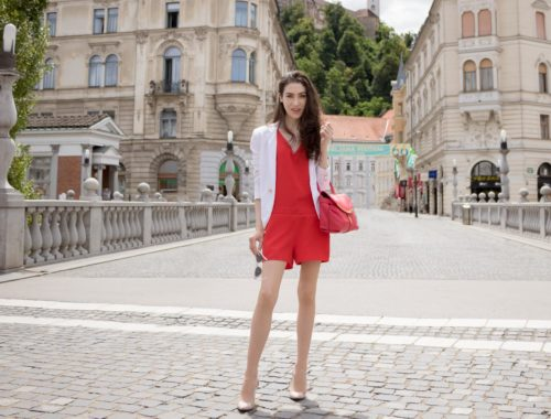 Veronika Lipar Fashion Blogger of Brunette from Wall Street wearing red romper, white blazer, Adam Selman x Le Specs white cat eye Lolita sunglasses, pink top handle See by Chloe bag, Gianvito Rossi plexi pumps