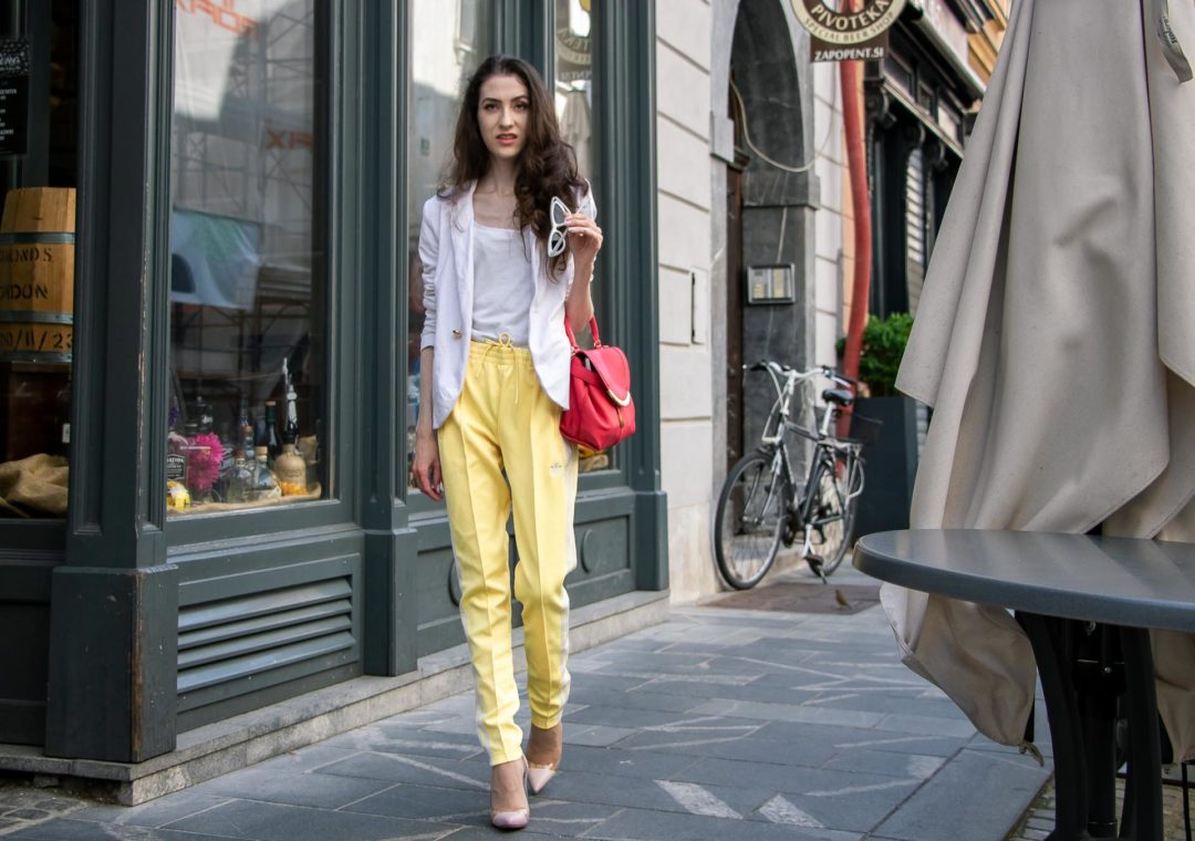 Veronika Lipar Fashion Editor of Brunette from Wall Street wearing white blazer, white H&M t-shirt, yellow Addidas track pants, See by Chloé pink top handle bag, Adam Selman x Le Specs white cat eye Lolita sunglasses, pink blush Gianvito Rossi plexi pumps on the street in the morning