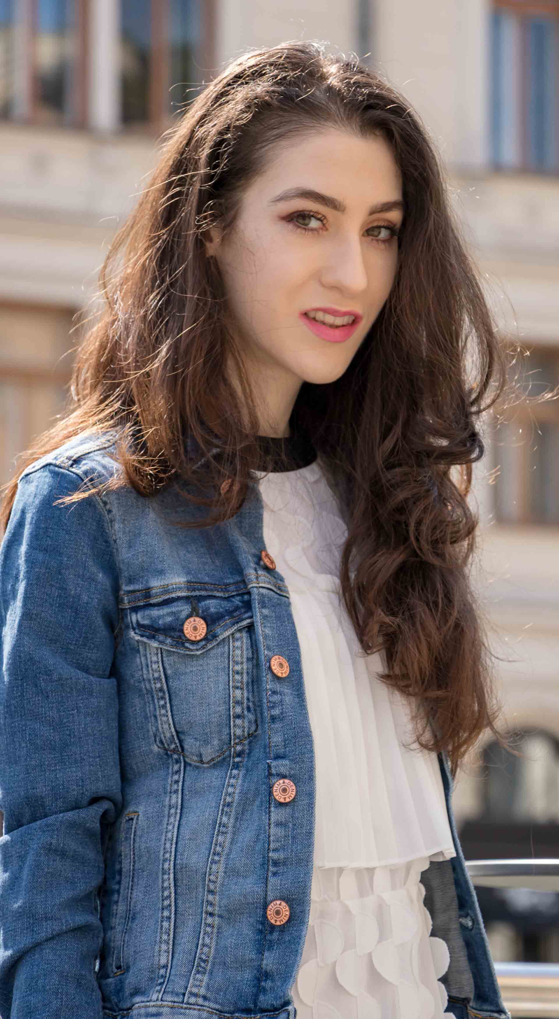 Veronika Lipar Fashion Editor of Brunette from Wall Street wearing H&M blue denim jacket, Storets white pleated short dress
