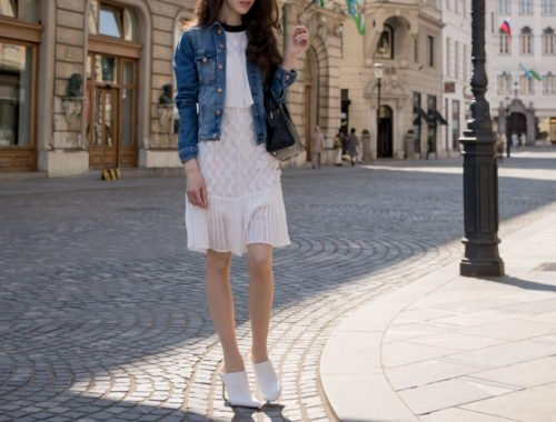 Veronika Lipar Fashion Editor of Brunette from Wall Street dressed in H&M blue denim jacket, Storets white pleated short dress, white mules and Adam Selman x Le Specs white cat eye Lolita sunglasses, black small bag in Ljubljana
