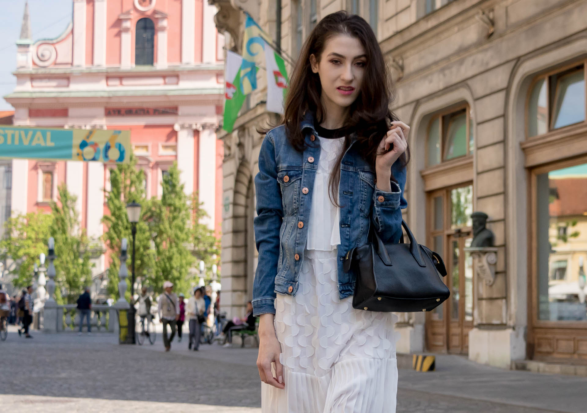 Veronika Lipar Fashion Editor of Brunette from Wall Street wearing H&M blue denim jacket, Storets white pleated short dress, small tote bag