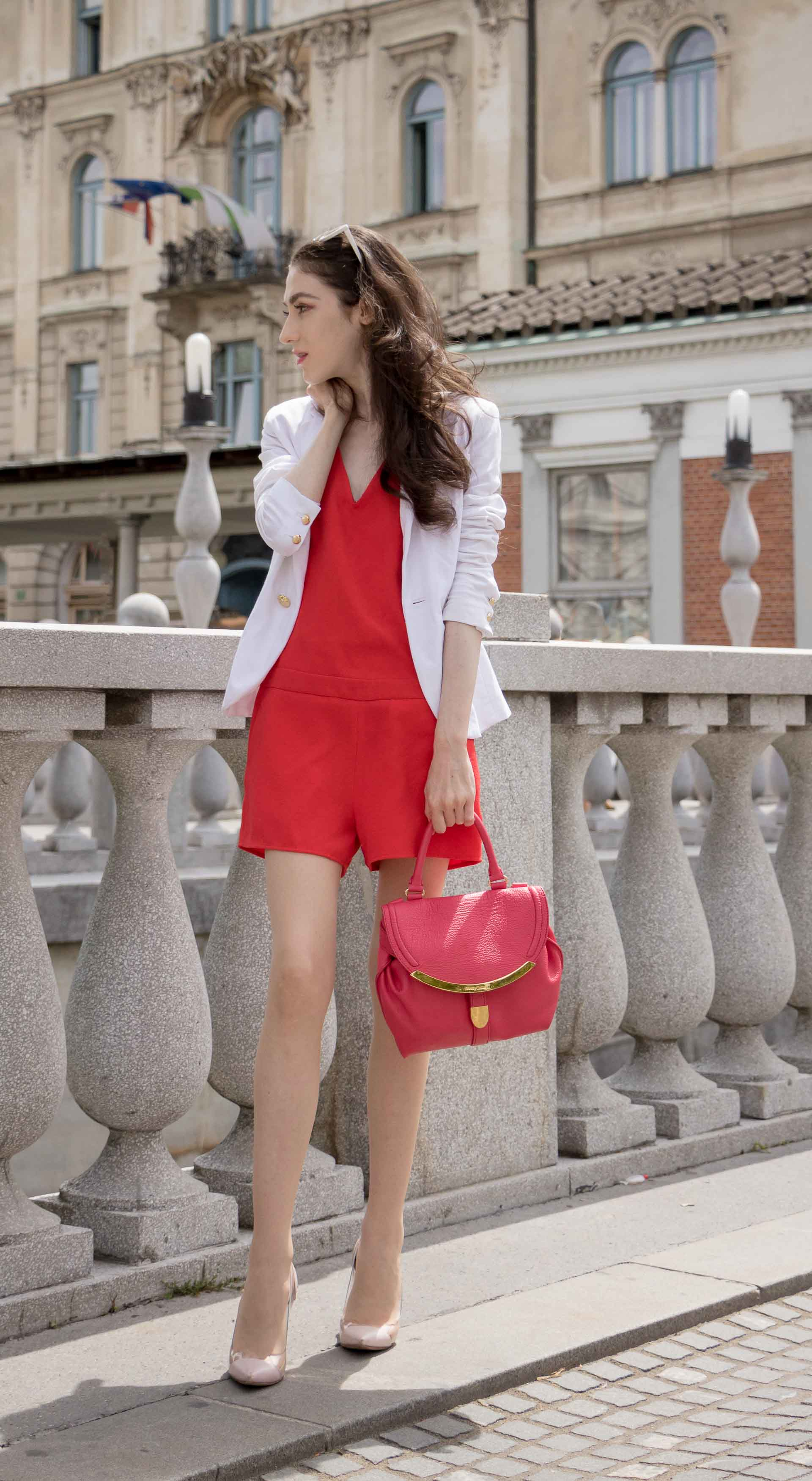 Veronika Lipar Fashion Blogger of Brunette from Wall Street dressed in red playsuit, white blazer, Adam Selman x Le Specs white cat eye Lolita sunglasses, pink top handle See by Chloe bag, Gianvito Rossi plexi pumps