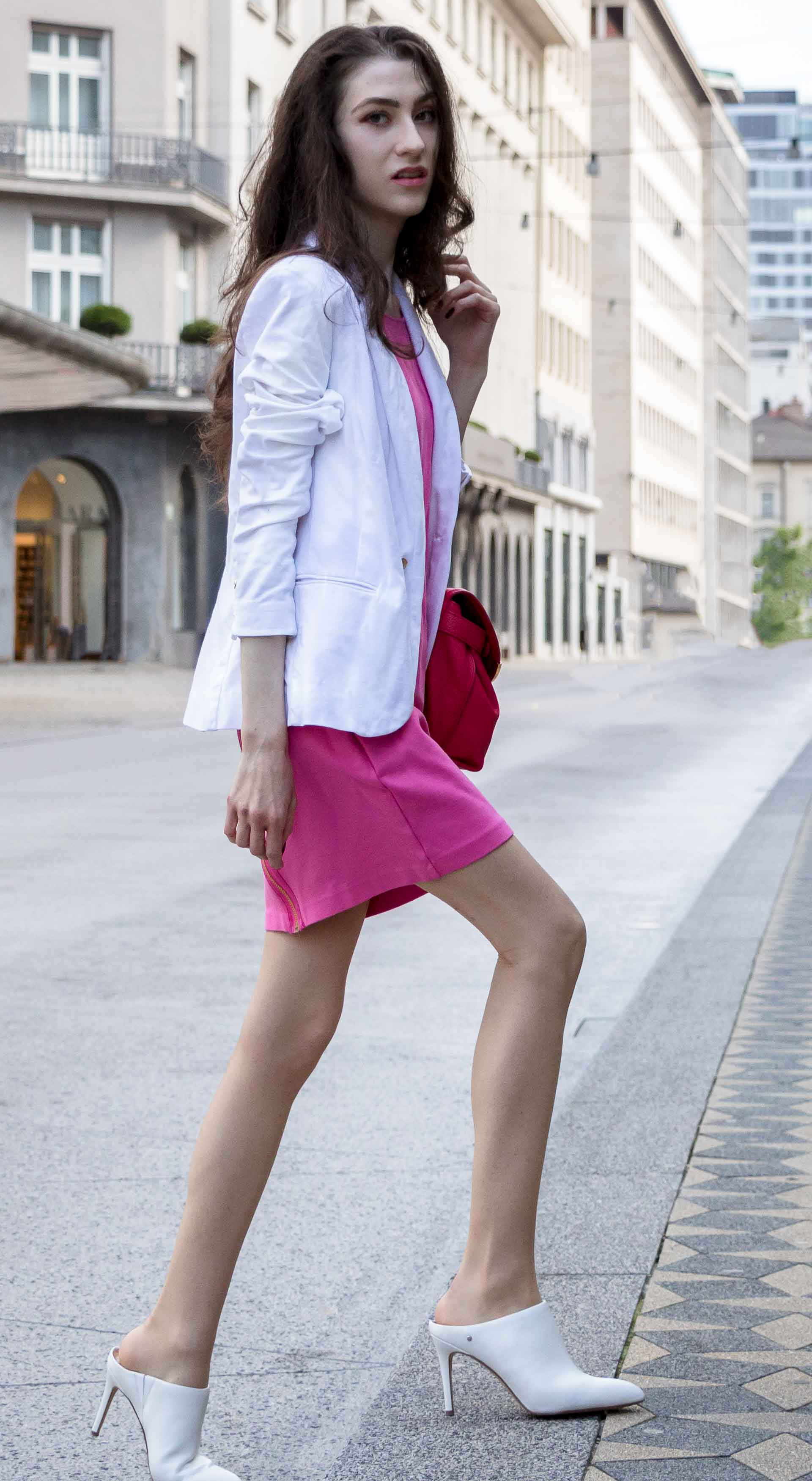 Fashion Blogger Veronika Lipar of Brunette from Wall Street wearing white high heel close toe mules, pink tailored short dress, white blazer, pink top handle bag for work in summer