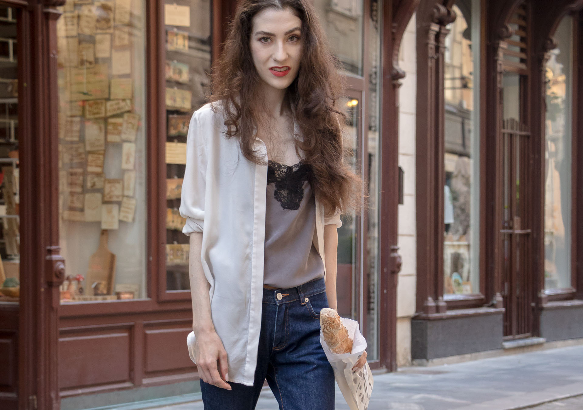 Fashion Blogger Veronika Lipar of Brunette from Wall Street wearing white sheer shirt with transparent back from Sandro Paris, grey silk slip top