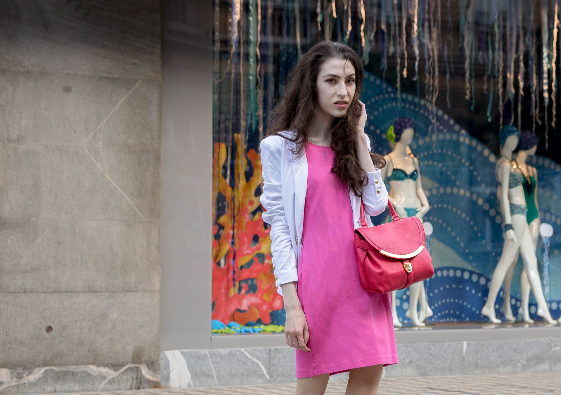 Fashion Blogger Veronika Lipar of Brunette from Wall Street wearing pink tailored short dress, white blazer, pink top handle bag for work in summer
