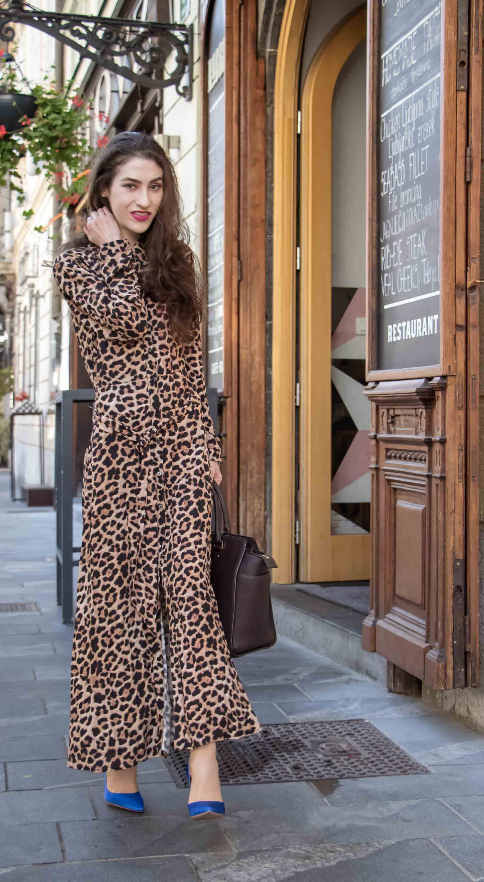 3f6f8fe53239 Beautiful Slovenian Fashion Blogger Veronika Lipar of Brunette from Wall  dressed in long leopard dress from