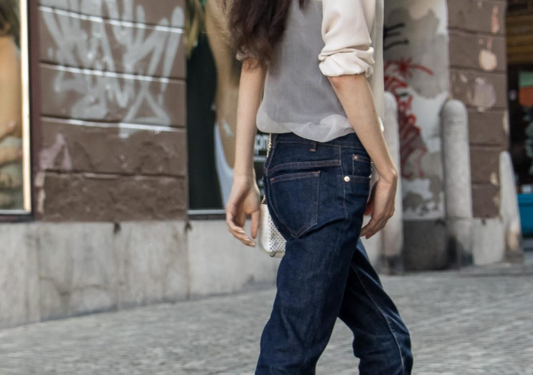 Beautiful Slovenian Fashion Blogger Veronika Lipar of Brunette from Wall wearing chic outfit, white silk shirt from Sandro Paris, A.P.C. straight-leg dark denim jeans