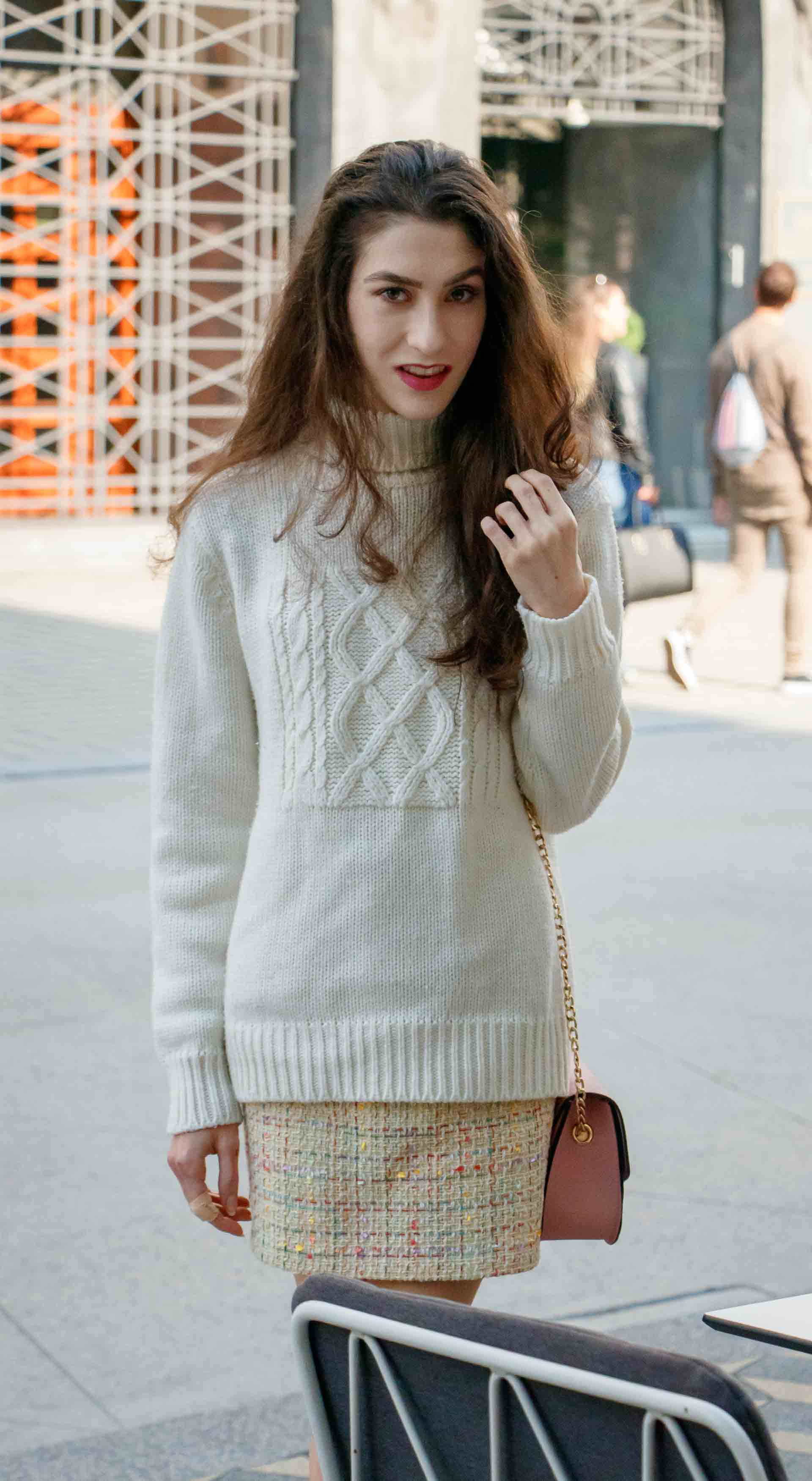 Beautiful Slovenian Fashion Blogger Veronika Lipar of Brunette from Wall wearing yellow tweed skirt, white turtleneck sweater, chain strap shoulder bag for fall brunch