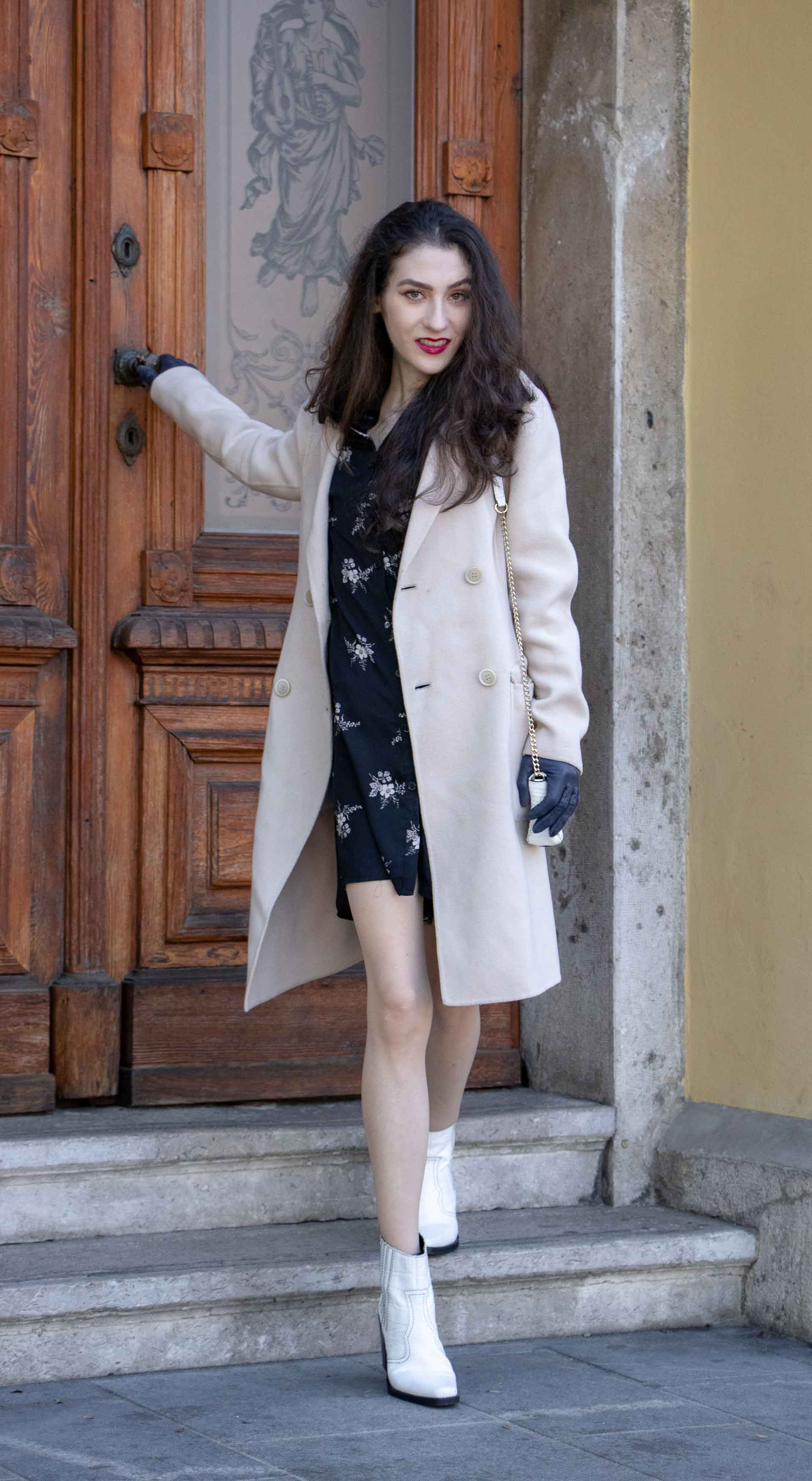 Beautiful Slovenian Fashion Blogger Veronika Lipar of Brunette from Wall wearing dark floral shirtdress with white Ganni cowboy boots, white chain shoulder bag in autumn leaving home closing the door
