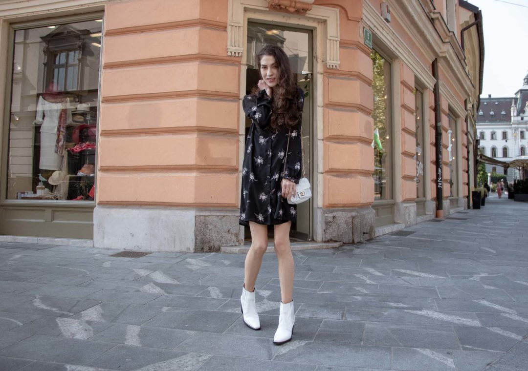 Slovenska modna blogerka Slovenian Fashion Blogger Veronika Lipar of Brunette from Wall Street wearing black floral button down shirt dress, white shoulder bag, white Ganni boots on Friday on the street