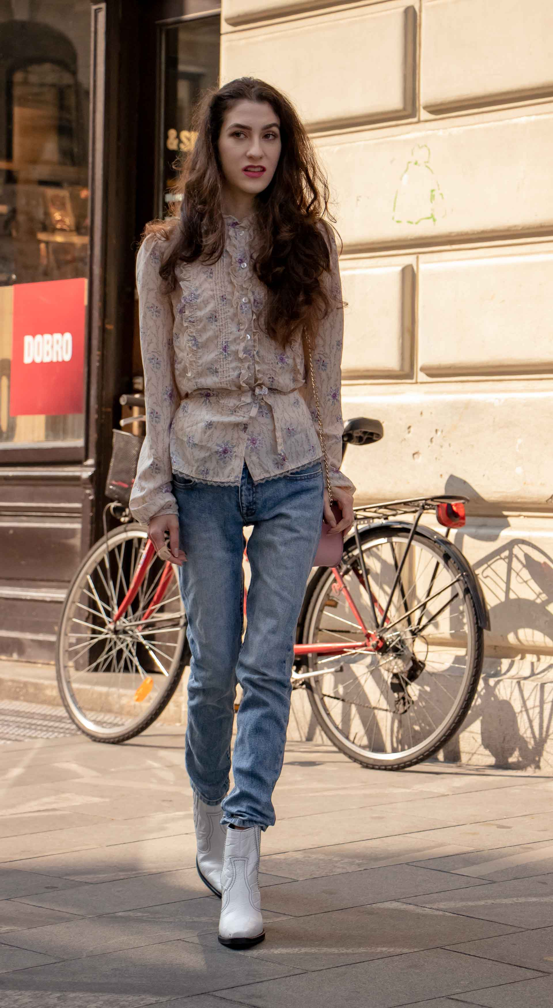 Beautiful Slovenian Fashion Blogger Veronika Lipar of Brunette from Wall dressed in floral long sleeved Prairie blouse, A.P.C. blue jeans on the street in autumn in Ljubljana