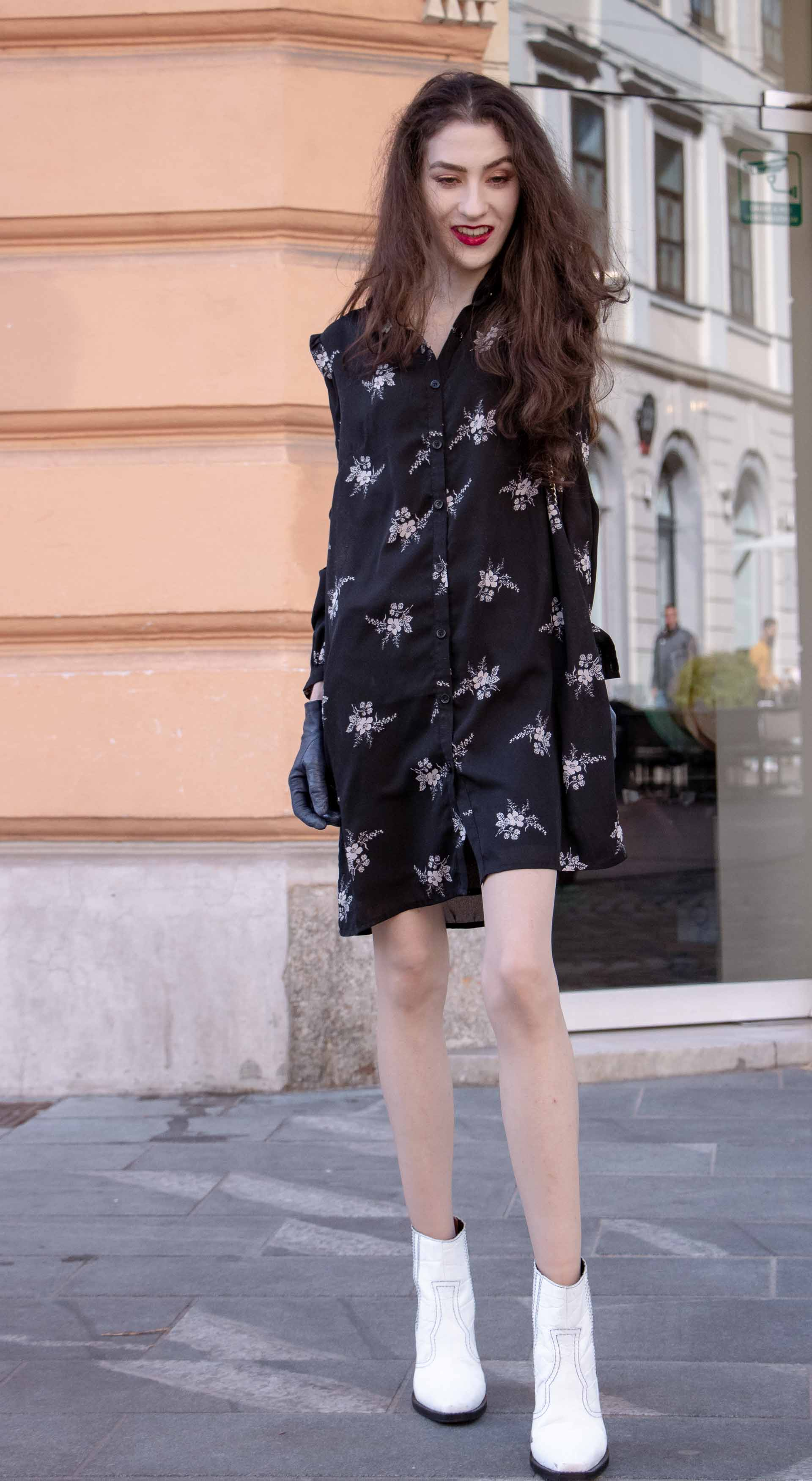 Beautiful Slovenian Fashion Blogger Veronika Lipar of Brunette from Wall dressed in dark floral shirtdress with white Ganni cowboy boots, white chain shoulder bag in autumn on the street in Ljubljana