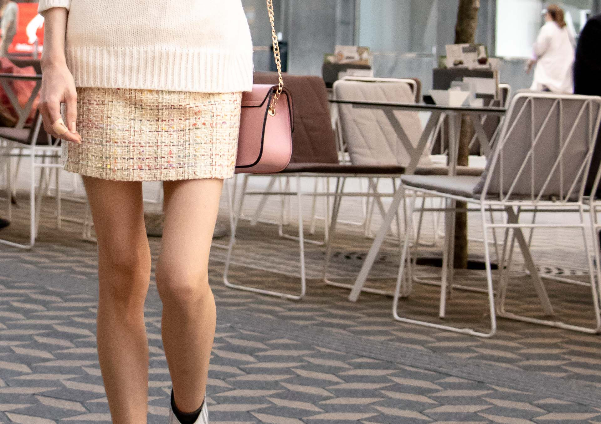 Beautiful Slovenian Fashion Blogger Veronika Lipar of Brunette from Wall dressed in white Ganni Western boots, yellow tweed skirt, white turtleneck sweater, chain strap shoulder bag for autumn brunch