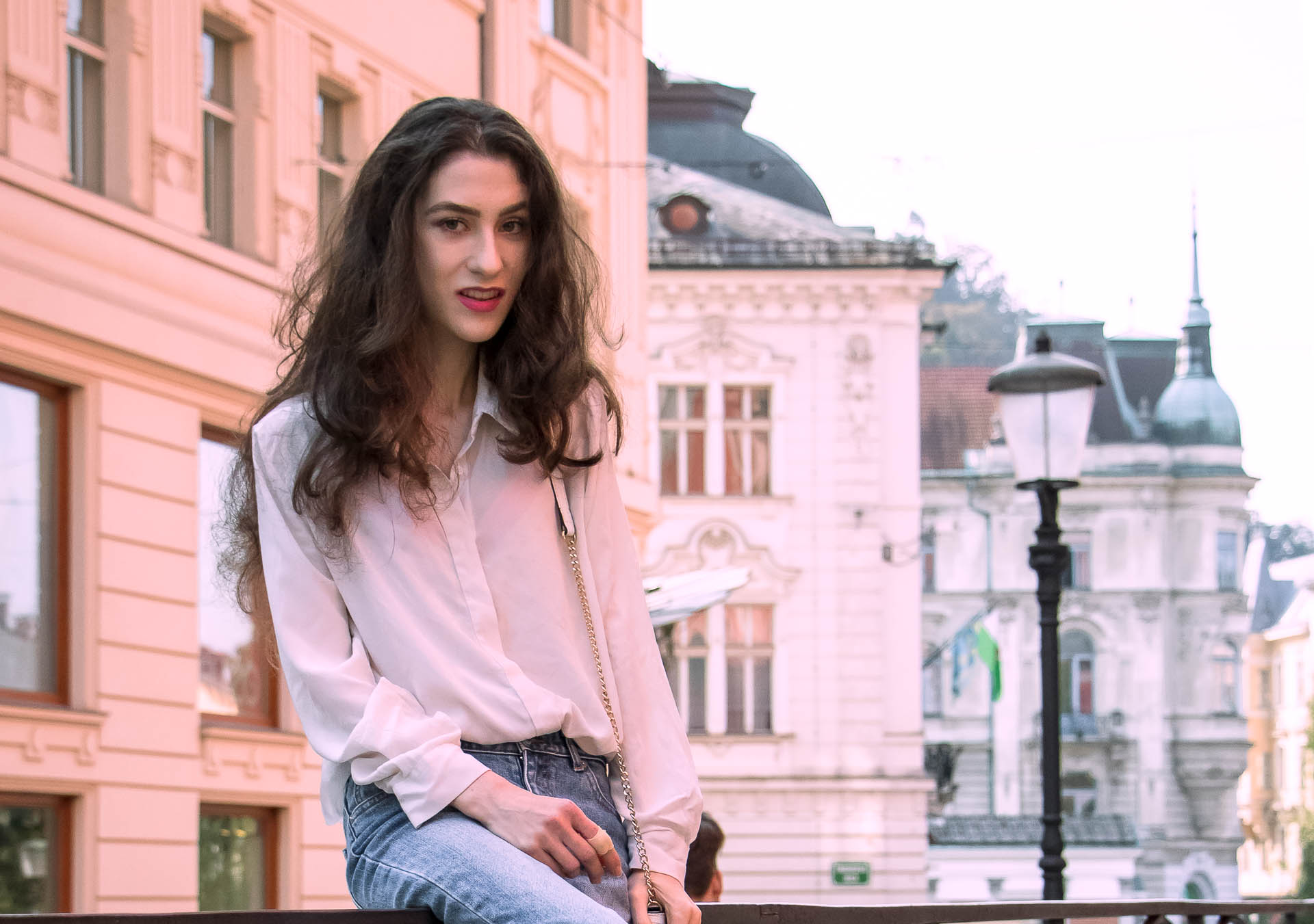 Beautiful Slovenian Fashion Blogger Veronika Lipar of Brunette from Wall dressed in chic everyday outfit white silk shirt from Sandro Paris, white and black polka dot cami slip top, A.P.C. light blue jeans