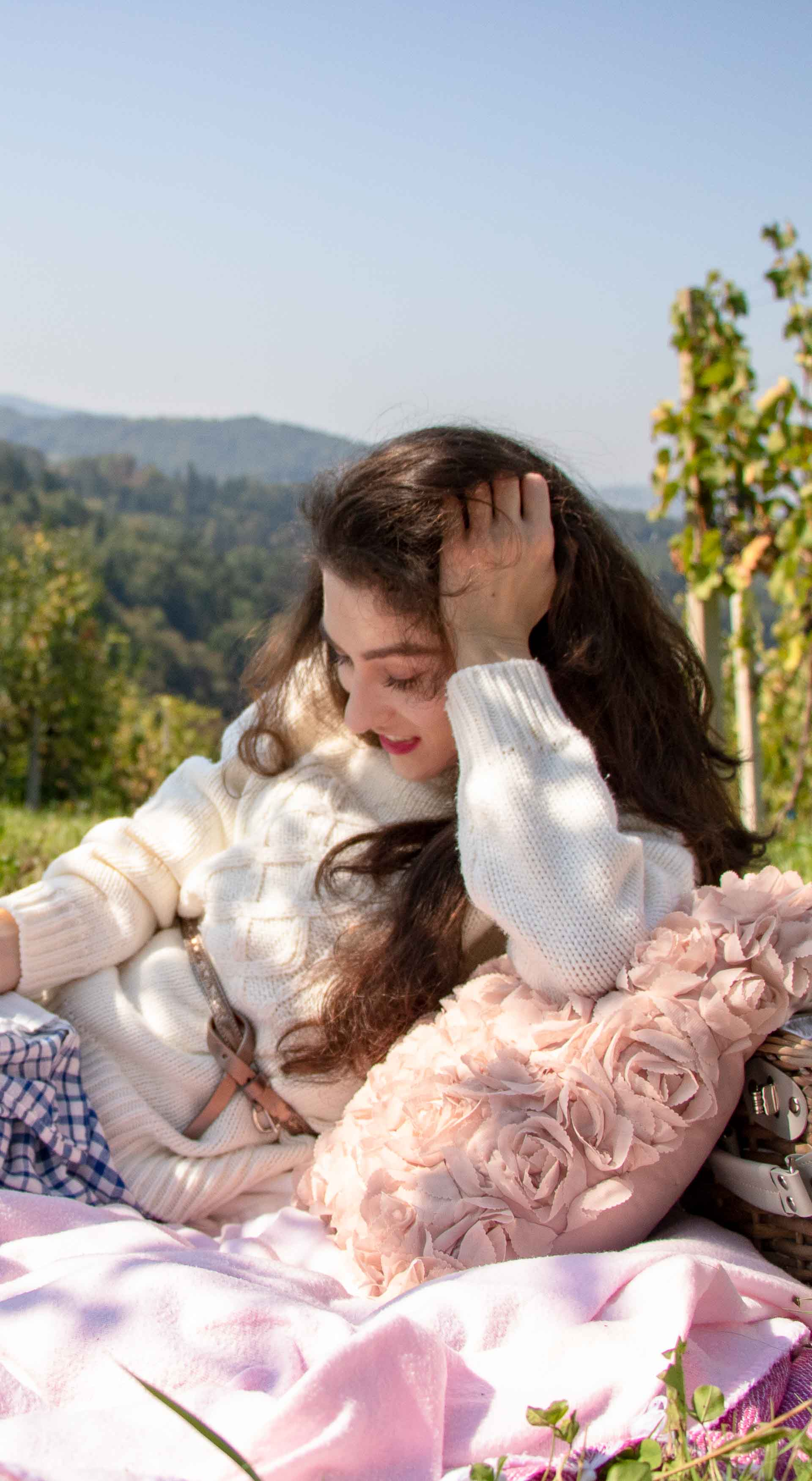 Beautiful Slovenian Fashion Blogger Veronika Lipar of Brunette from Wall Street wearing blue and white check button down Mango dress, oversized white turtleneck sweater, dangling belt, white Ganni cowboy boots, for fall picnic in countryside