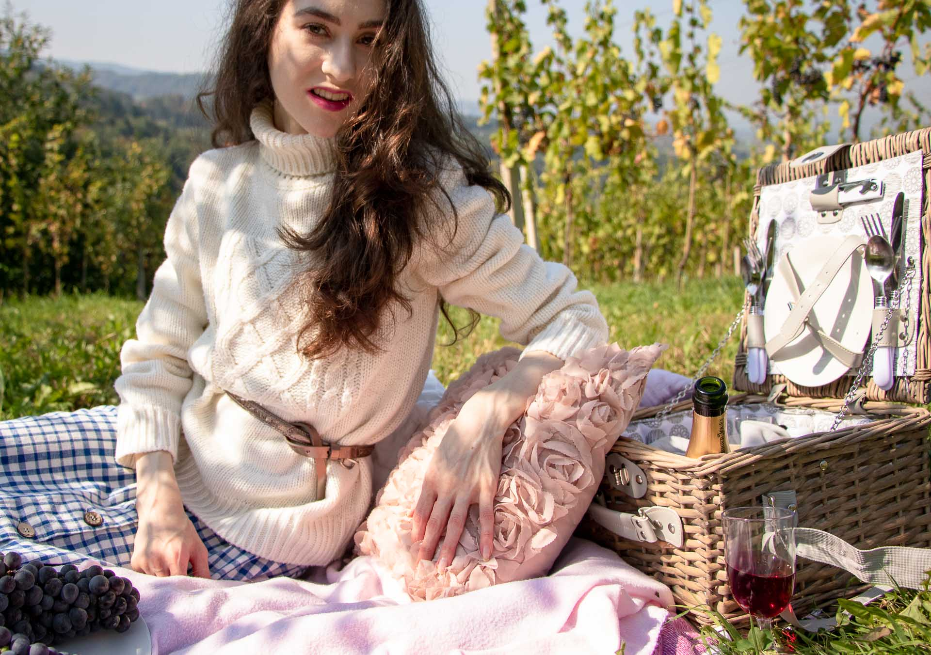 Beautiful Slovenian Fashion Blogger Veronika Lipar of Brunette from Wall wearing blue and white check button down Mango dress, oversized white turtleneck sweater, dangling belt, white Ganni cowboy boots, for autumn picnic in vineyard